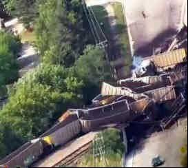 Derailed railroad cars loaded with coal piled onto the overpass, causing it to collapse, railroad officials say.