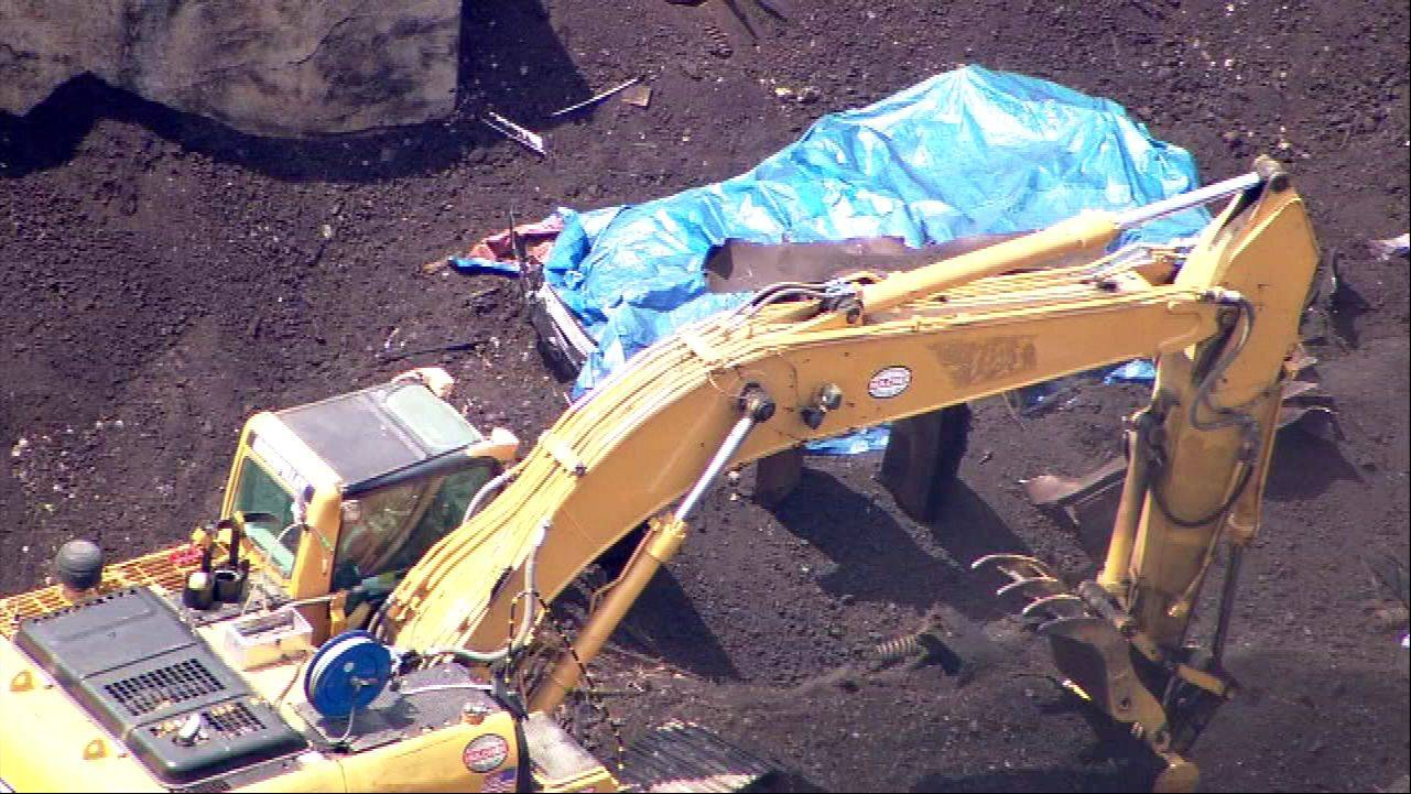COURTESY OF ABC 7A blue tarp is seen amid the debris as Thursday cleanup continues at the scene of a Wednesday train derailment near Glenview.