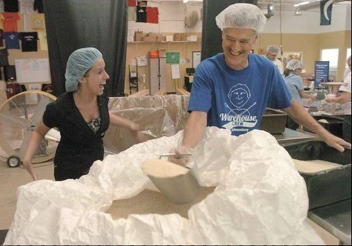 Feed My Starving Children volunteer Rich Direnzo shares a lighthearted moment at the Schaumburg facility.