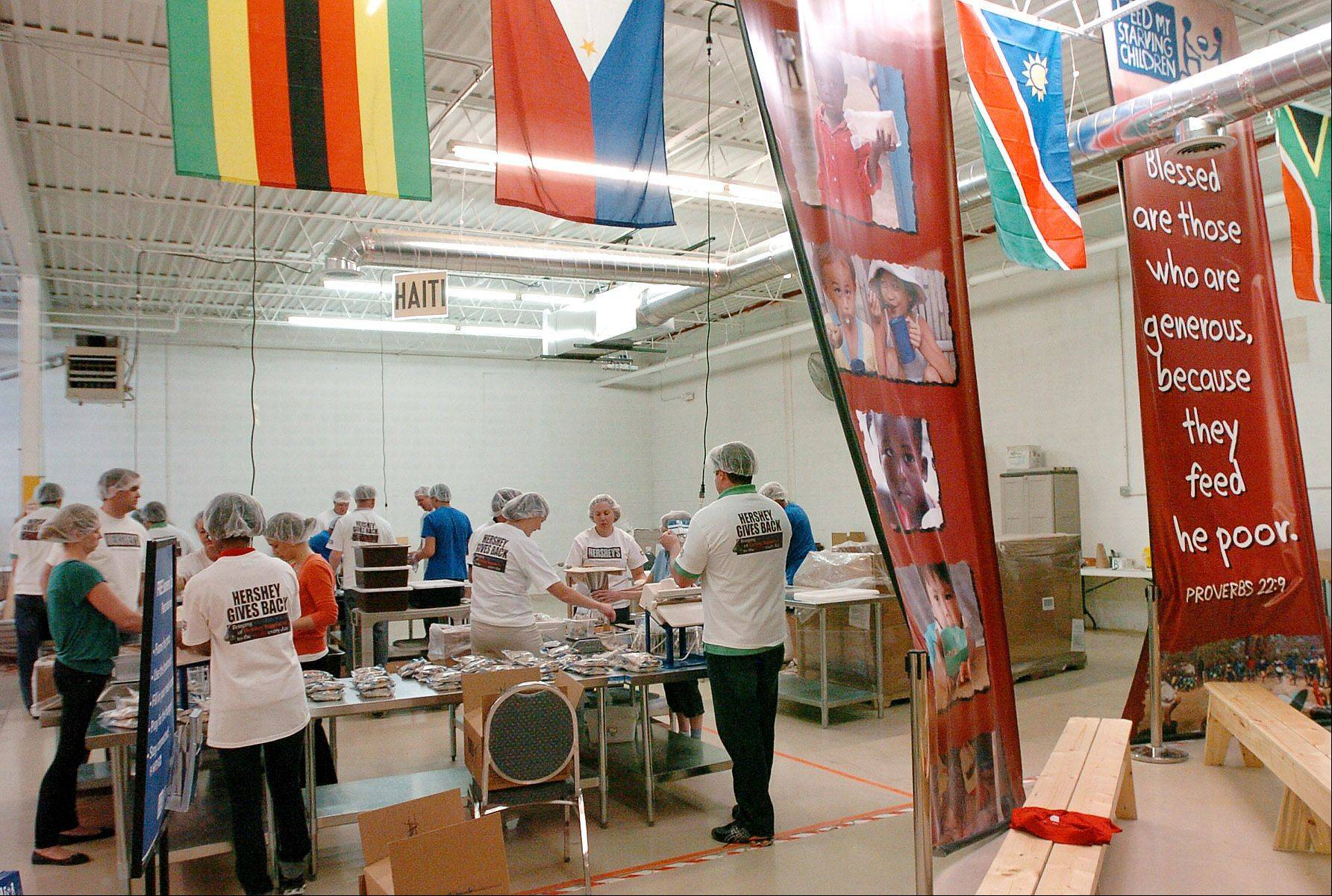 Volunteers from Hersheys in Deerfield pack meals for Feed My Starving Children in Schaumburg.
