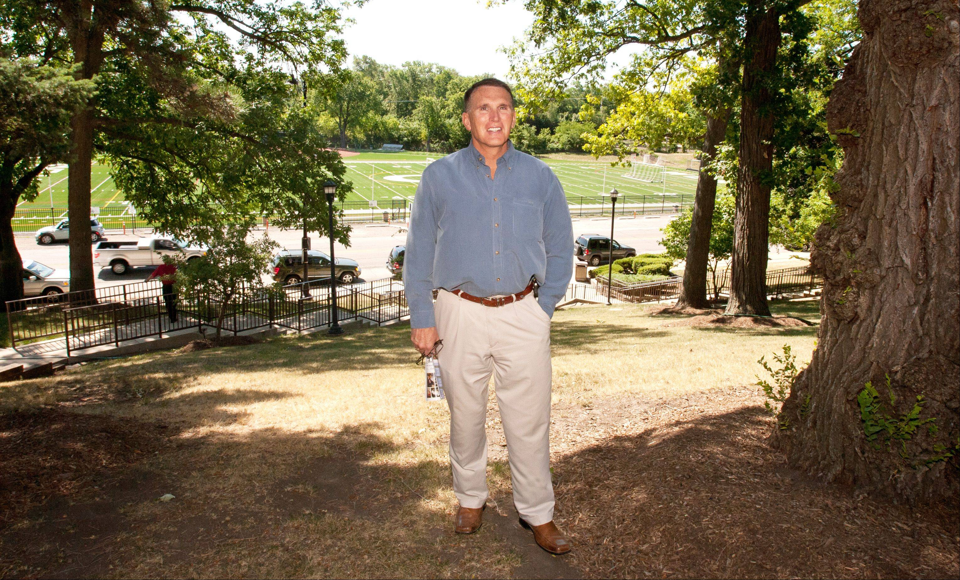 Mike Meissen stepped down last week after six years as superintendent of Glenbard High School District 87. He stands on a hill at Glenbard West overlooking Memorial Field, where his plan to install field lighting garnered opposition from neighbors.