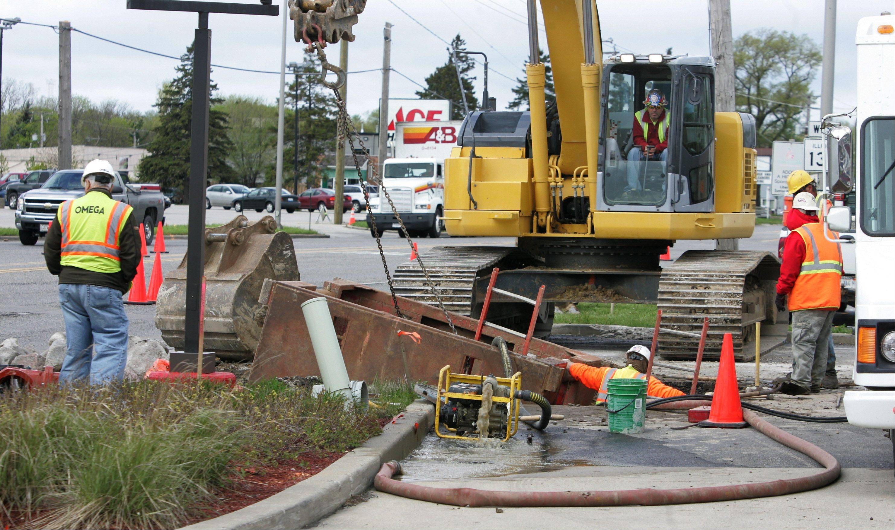 A Ricci/Welch construction crew works on a water main along Route 137 and Milwaukee Avenue in April, in advance of a road widening project that hasn't gotten under way.