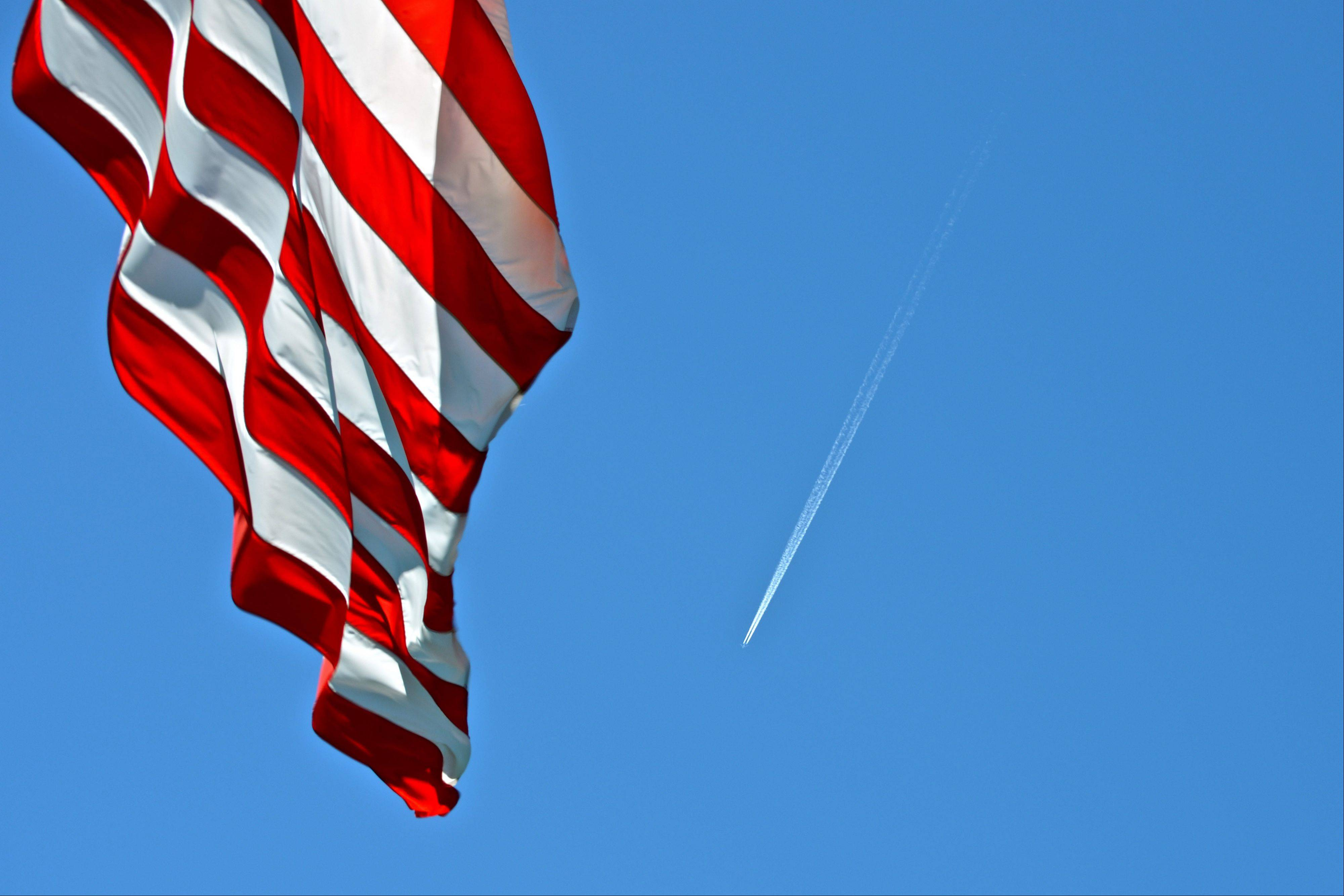 This photo was taken on the grounds of Cantigny Gardens and 1st Division Museum. When leaving I glanced back at the flag and noticed the jet contrail. An example of being in the right place at the right time.