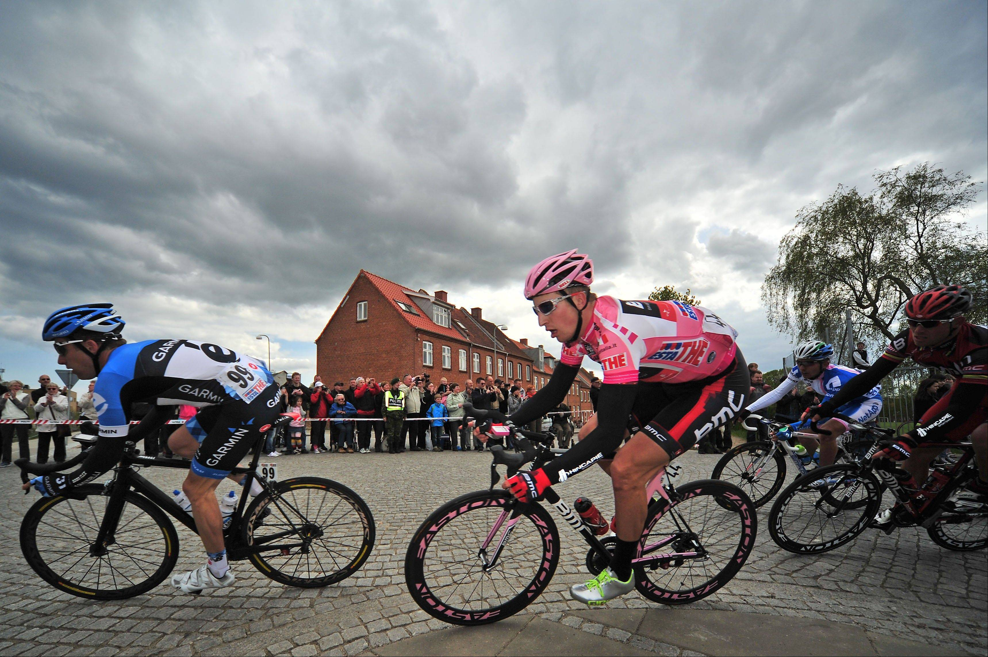 Taylor Phinney, second from left, wears the overall leader's pink jersey as he rides through a corner during the third stage of the Giro d'Italia on May 7.