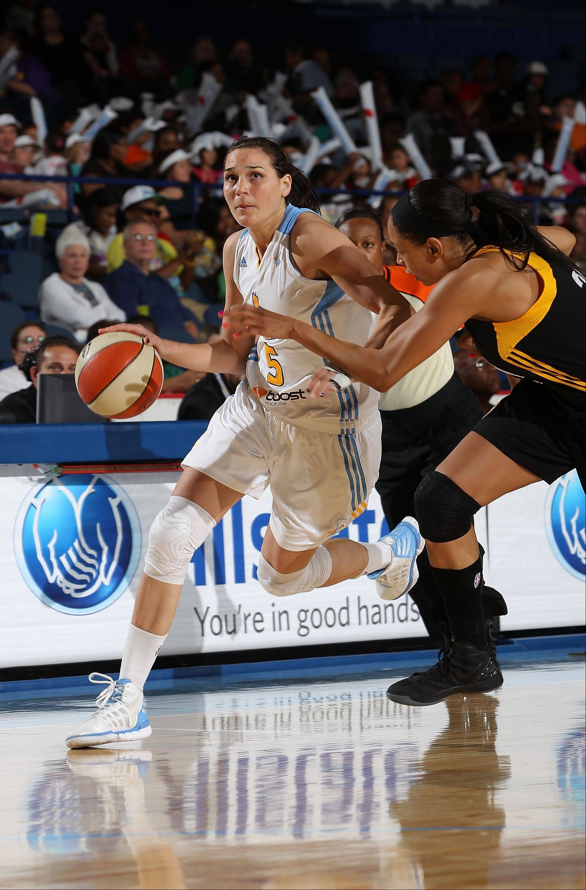 Sonja Petrovic of the Chicago Sky tries to drive past Jennifer Lacy of the Tulsa Shock. Although Petrovic is new to the Sky, she has played four years overseas for head coach Pokey Chatman.