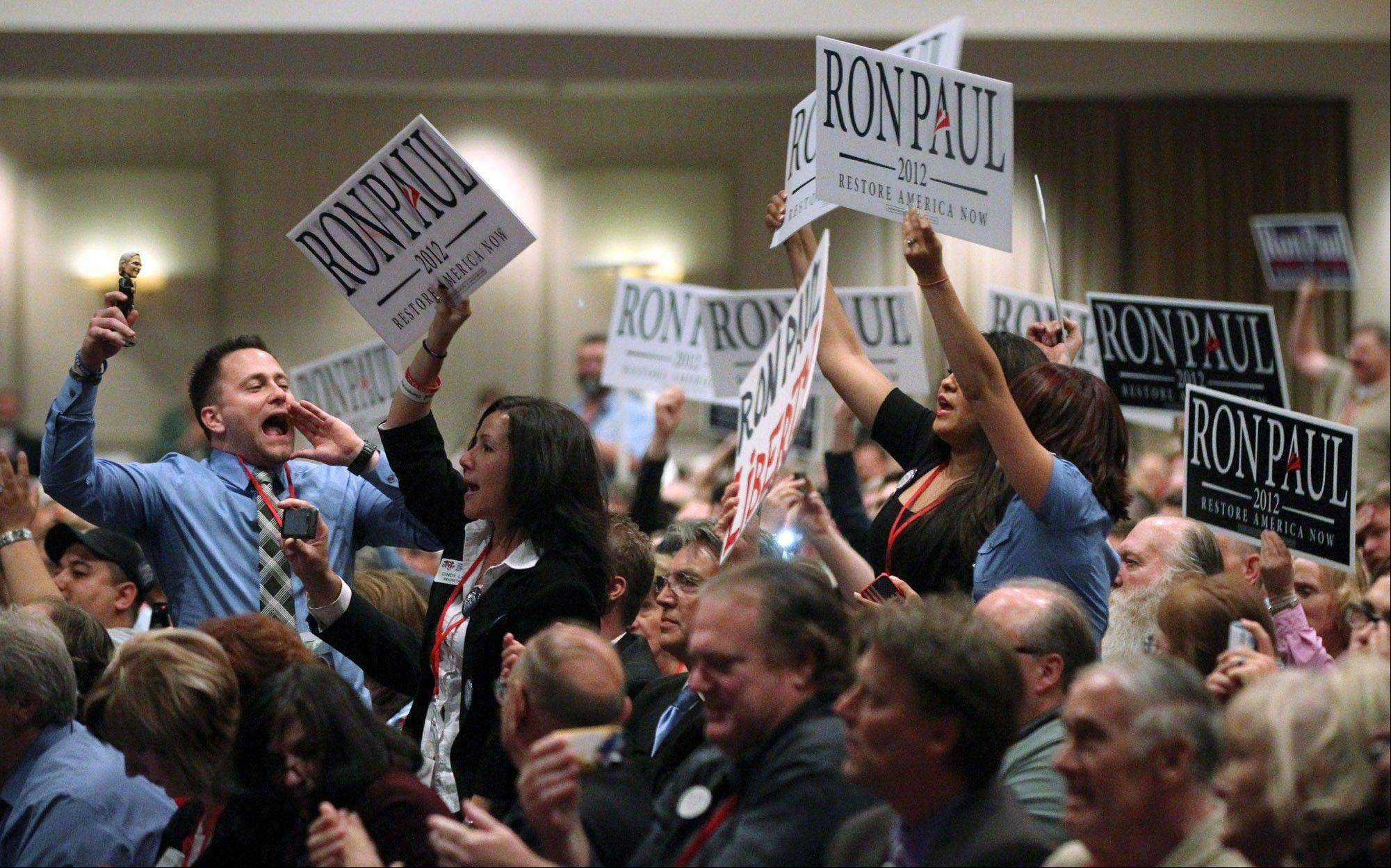 Associated Press/May 5, 2012 Supporters of GOP presidential candidate Ron Paul chant his name during the Nevada Republican Party Convention in Sparks, Nev. Standing second right is Cindy Lake, acting chair of the Clark County Republican Party and a delegate to the upcoming Republican National Convention.