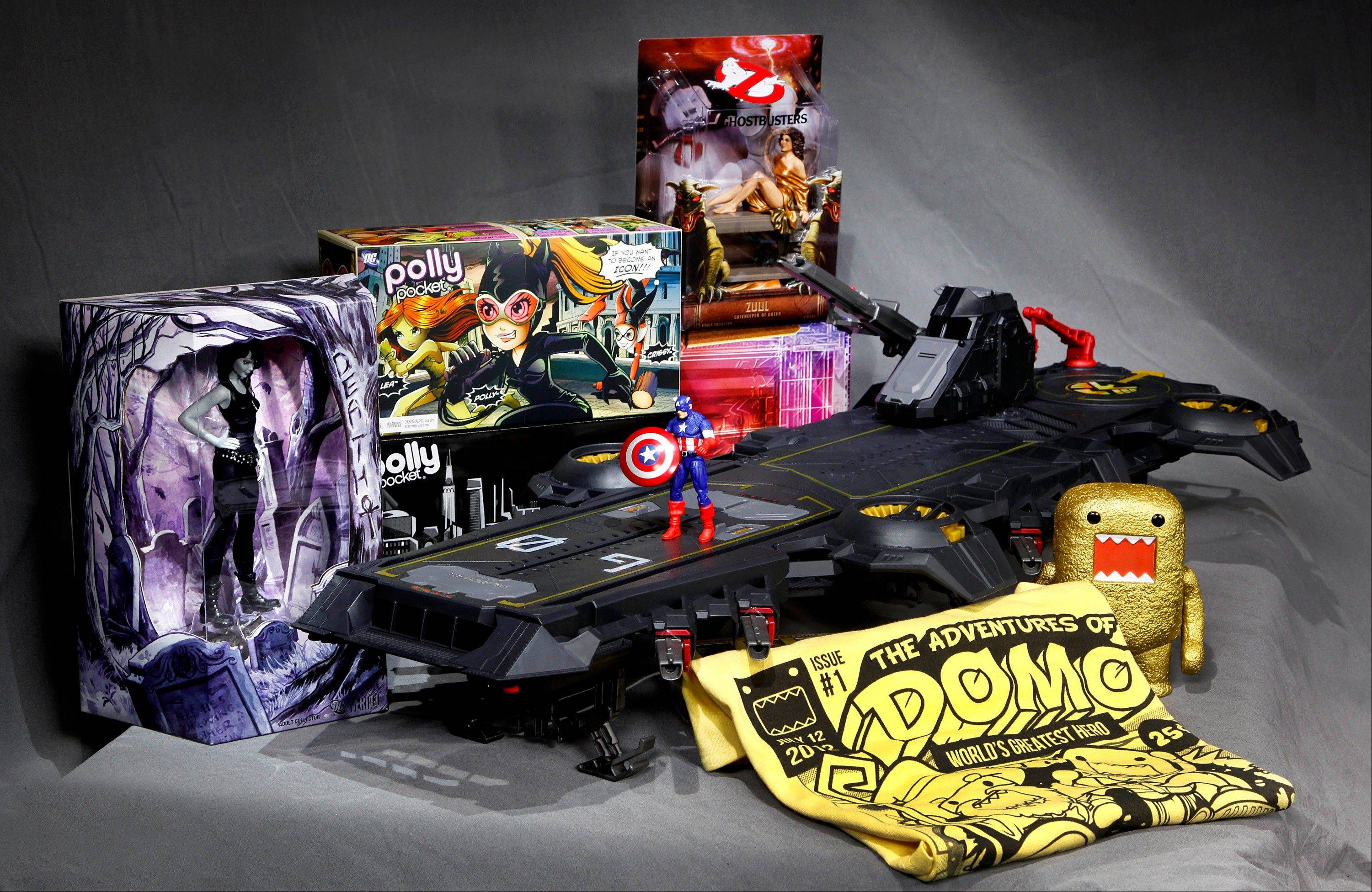 Associated Press/July 5, 2012 The Marvel Universe S.H.I.E.L.D. Super Helicarrier, at center with a Captain America figure on the foredeck, is seen with, from left background, a DC Comics Vertigo Death figurine, the Polly Pocket DC Comics Villain set, and a Dana as Zuul �Ghostbusters� figure, all special-issue Comic-Con 2012 collectibles, shown in Los Angeles.