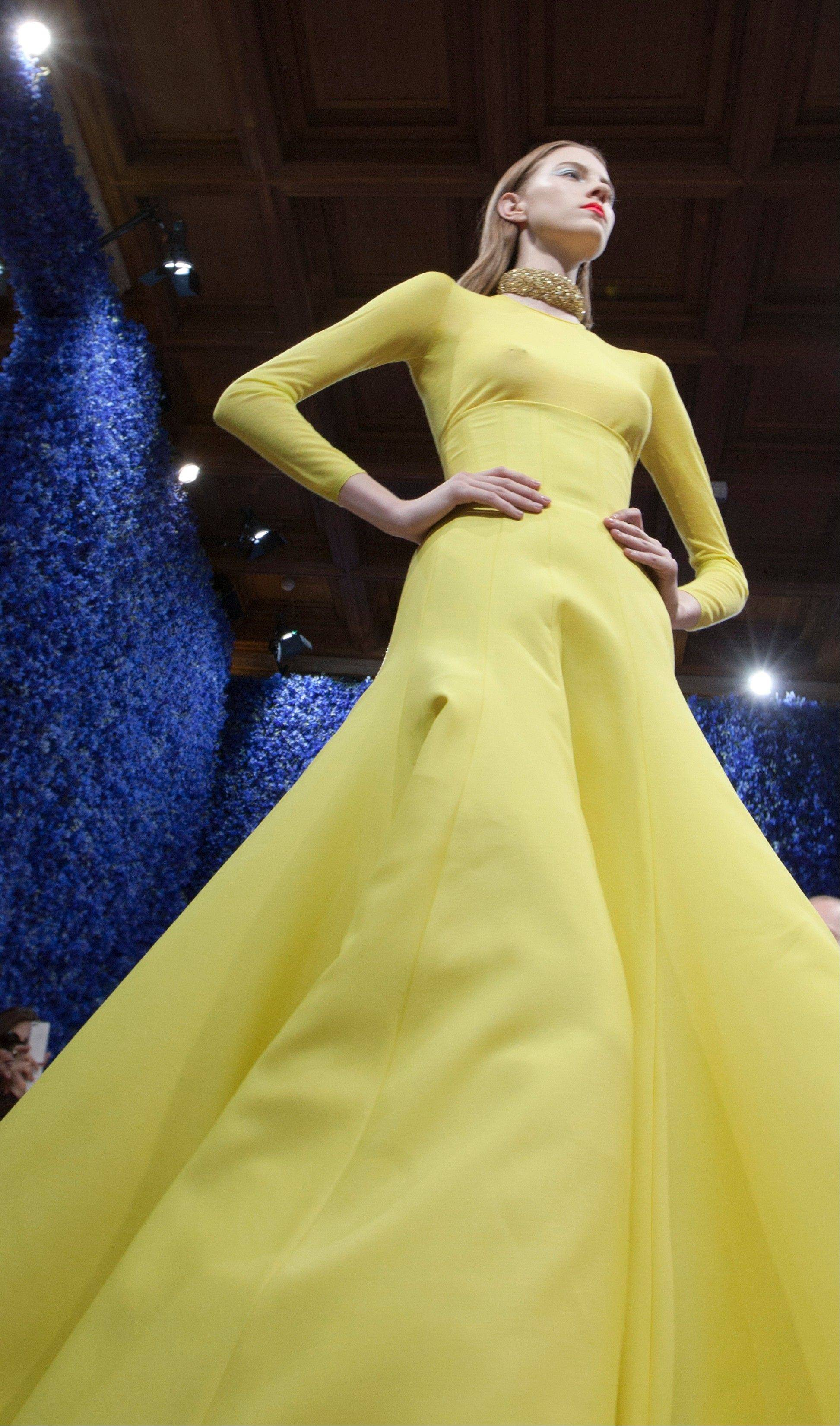 A model wears a creation by fashion designer Ralf Simons for Dior during his Women�s Fall Winter 2013 haute couture fashion collection in Paris.