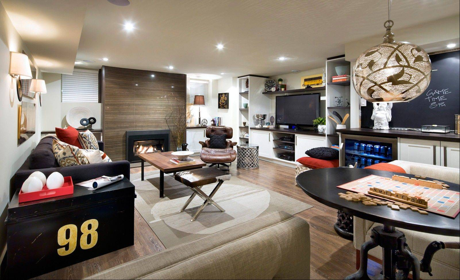 Warm colors, durable materials and accessories geared to this family�s love for games all contribute to the appeal of this space.