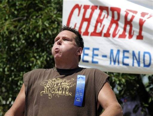 Ronn Matt, from Chicago, places first in the championship division of the 39th annual International Cherry Pit-Spitting Championship with a spit of 69 feet, Saturday Tree-Mendus Fruit Farm in Eau Claire, Mich.