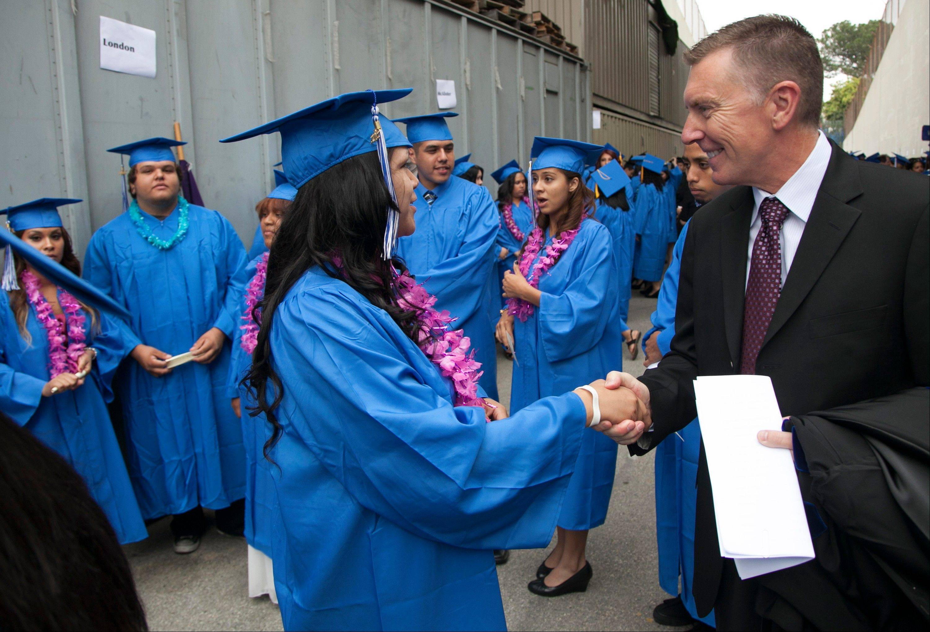 Los Angeles Unified School District Superintendent John Deasy tours the district in Los Angeles.