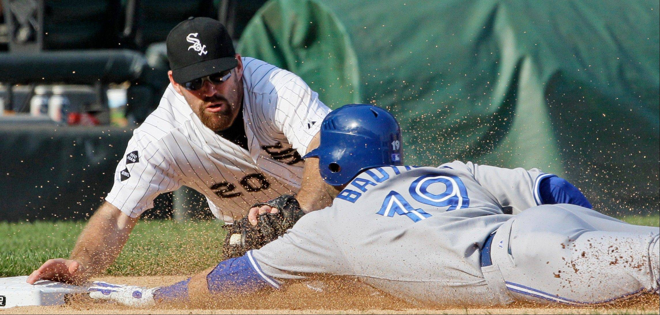 White Sox third baseman Kevin Youkilis tags out the Blue Jays� Jose Bautista in the ninth inning Saturday. It was Youkilis� 2-run homer in the fifth inning that tagged Toronto with the loss.