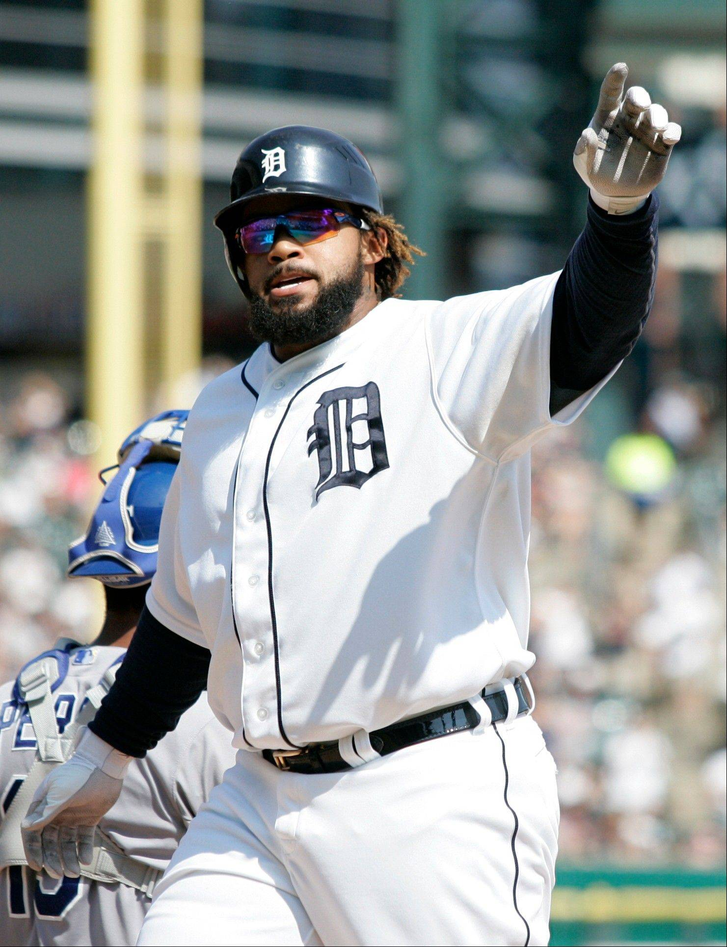 Detroit Tigers first baseman Prince Fielder acknowledges the crowd after hitting a two-run home run against the Kansas City Royals Saturday during the first inning in Detroit. The Tigers defeated the Royals 8-7.