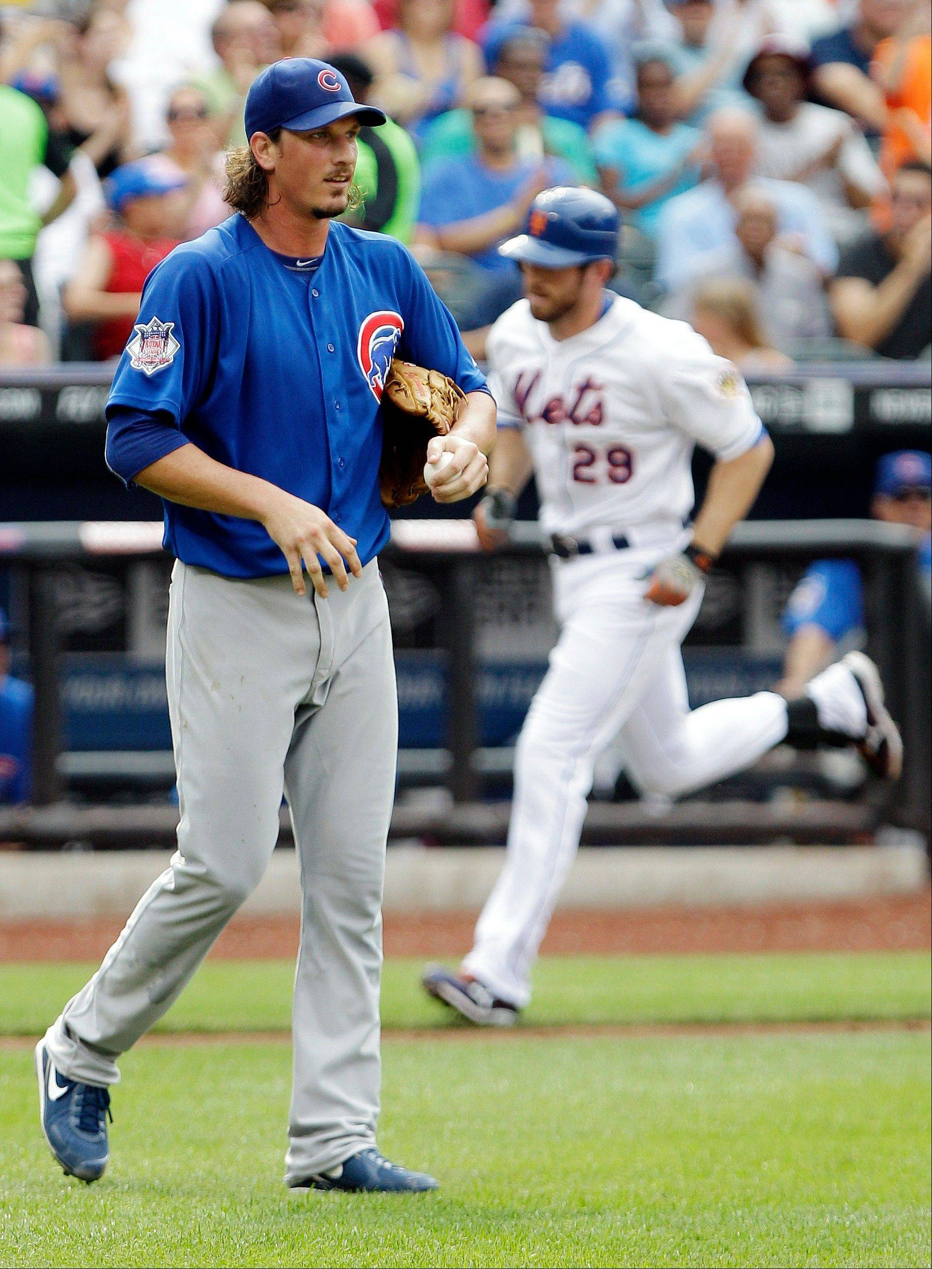 Cubs starting pitcher Jeff Samardzija reacts Saturday as New York Mets first baseman Ike Davis runs the bases Saturday after hitting a 2-run home run during the third inning in New York.