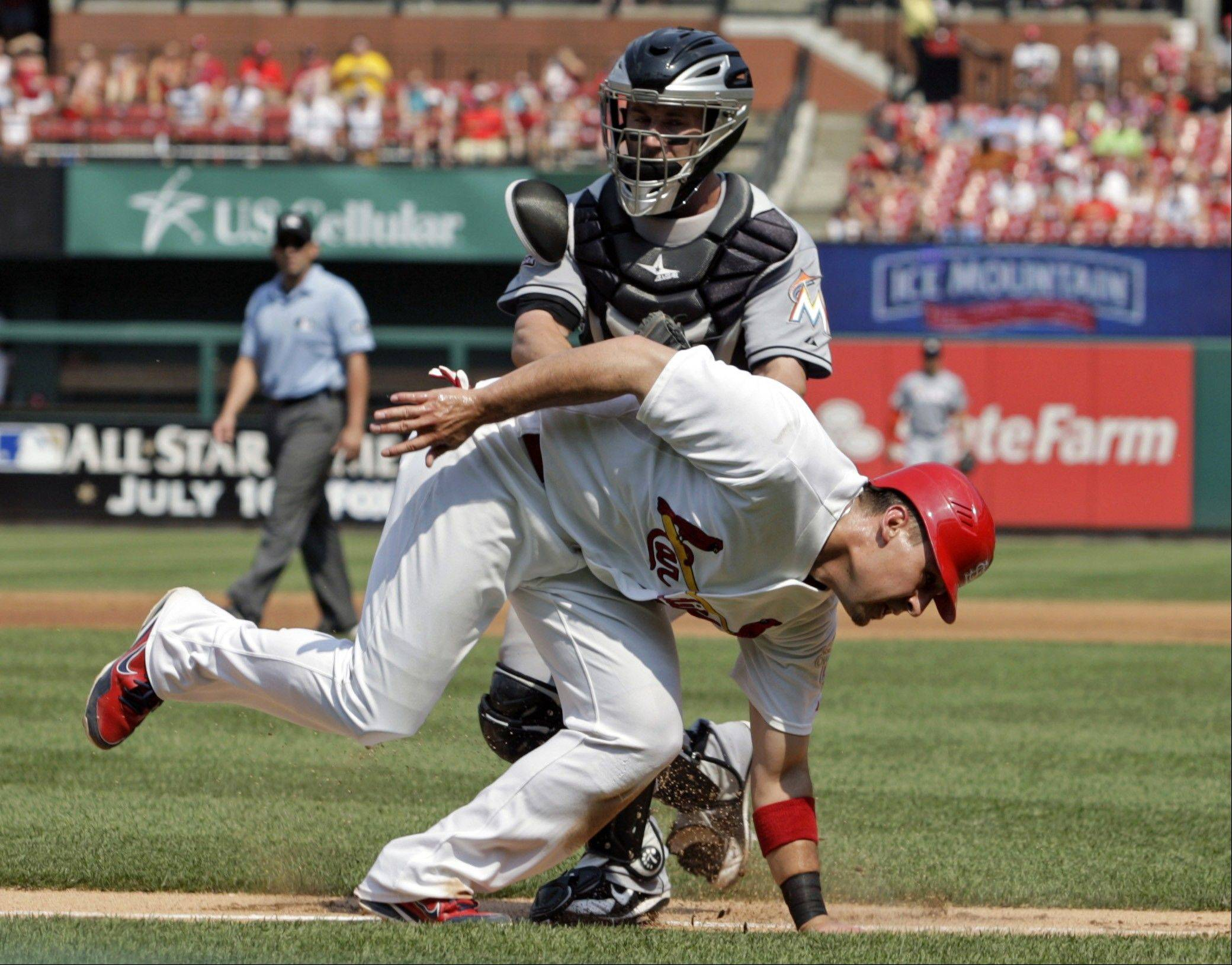 The St. Louis Cardinals� Allen Craig is tagged out by Miami Marlins catcher Brett Hayes Saturday after being caught in a rundown between third and home during the second inning in St. Louis.