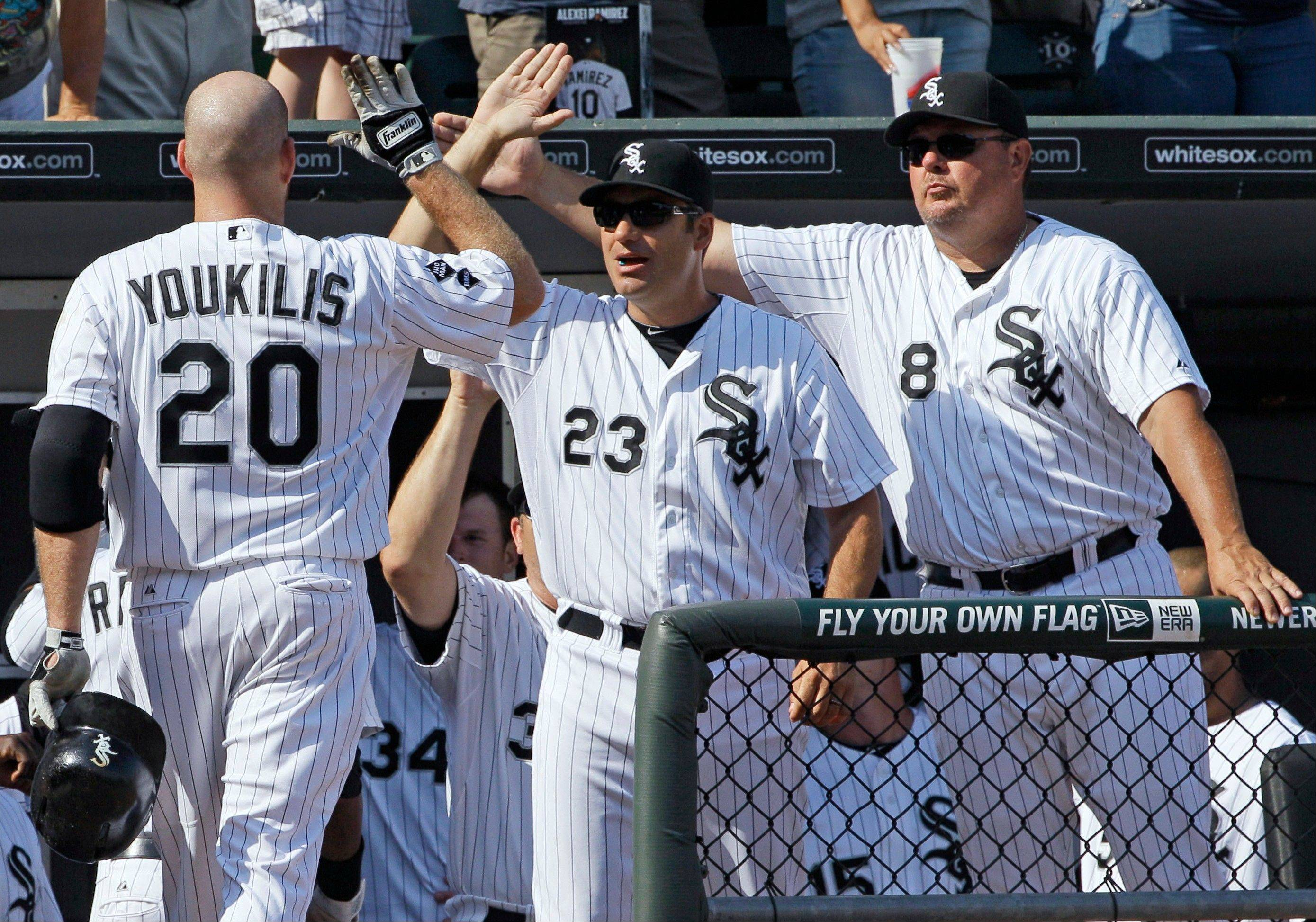 White Sox third baseman Kevin Youkilis, left, celebrates Saturday with manager Robin Ventura, center, and bench coach Mark Parent after hitting a two-run home run during the fifth inning against the Toronto Blue at U.S. Cellular Field.