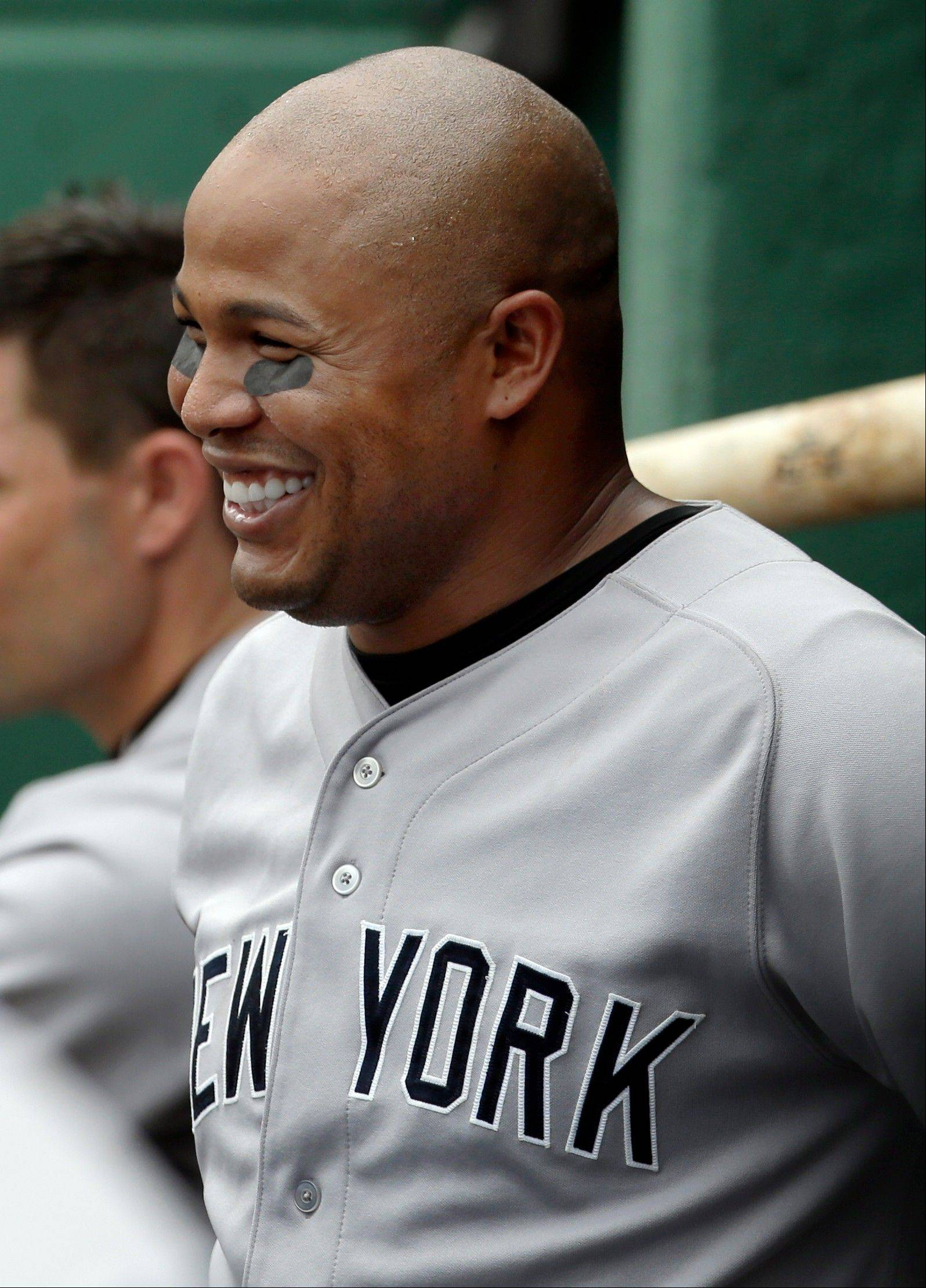 The New York Yankees� Andruw Jones smiles in the dugout Saturday after hitting his second solo home run against the Boston Red Sox during the fourth inning in the first game of a day-night doubleheader at Fenway Park in Boston.