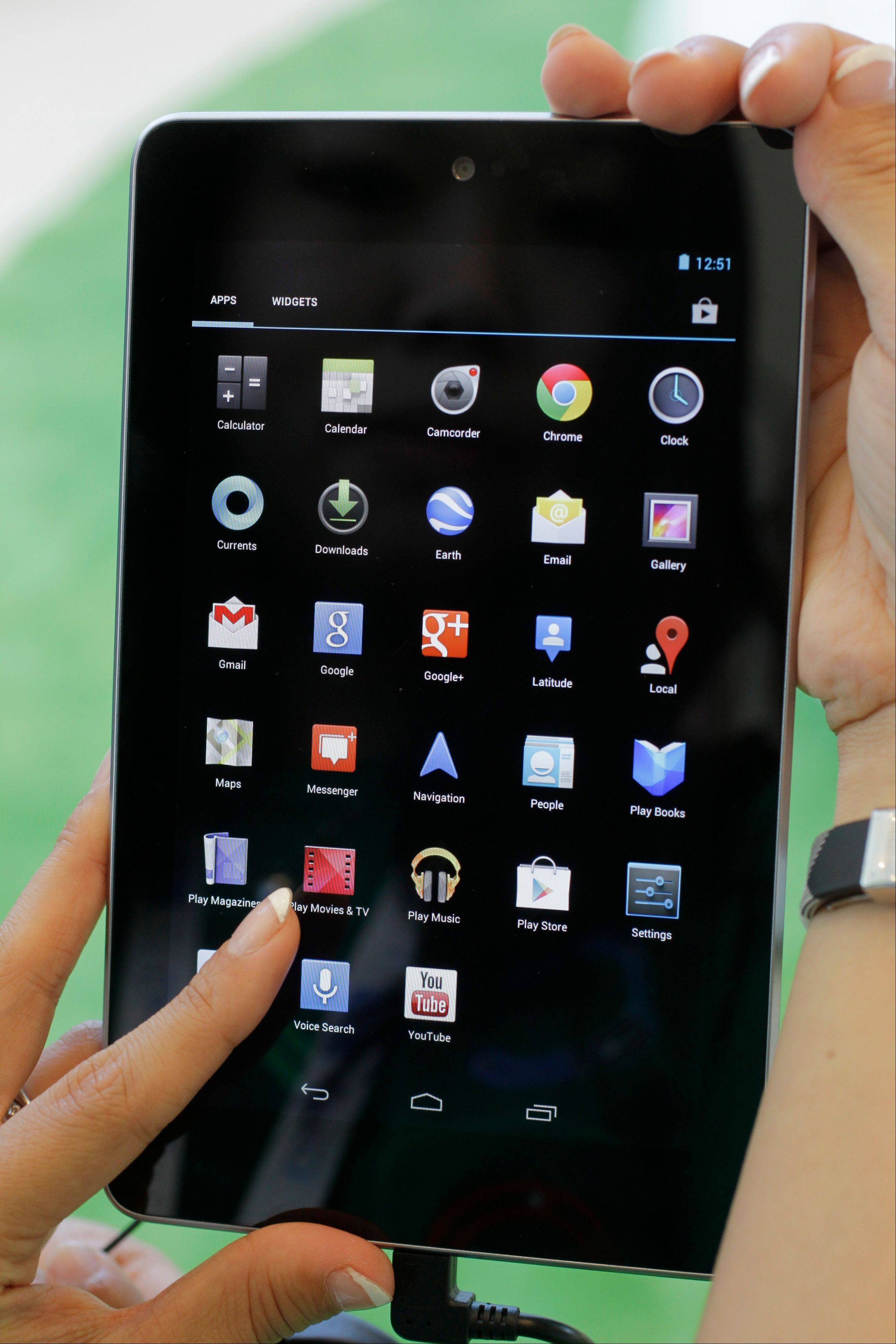 Google's Cheryl Pon shows off apps on the new Google Nexus 7 tablet at the Google I/O conference in San Francisco on June 27. The Nexus 7 costs $199, the same that Amazon and Barnes & Noble charge for their tablet. Google is taking preorders for delivery in mid-July.