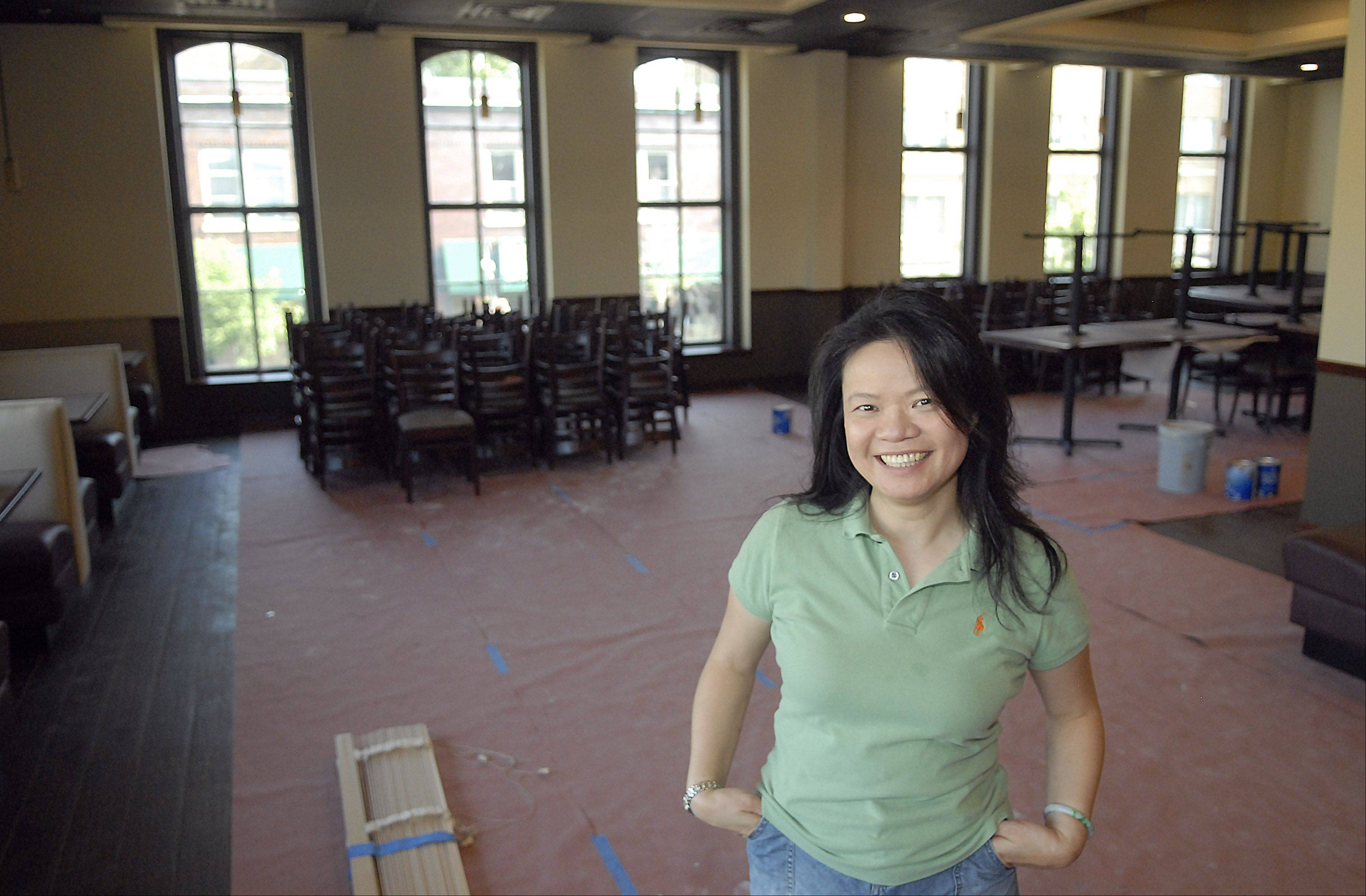 Nancy Chen, owner of Szechwan Restaurant in downtown St. Charles, is nearly ready to reopen her restaurant after being closed for 11 months due to a near-collapse of the building. New to the restaurant are an elevator and bar area, as well as a slightly larger dining room with more window views.