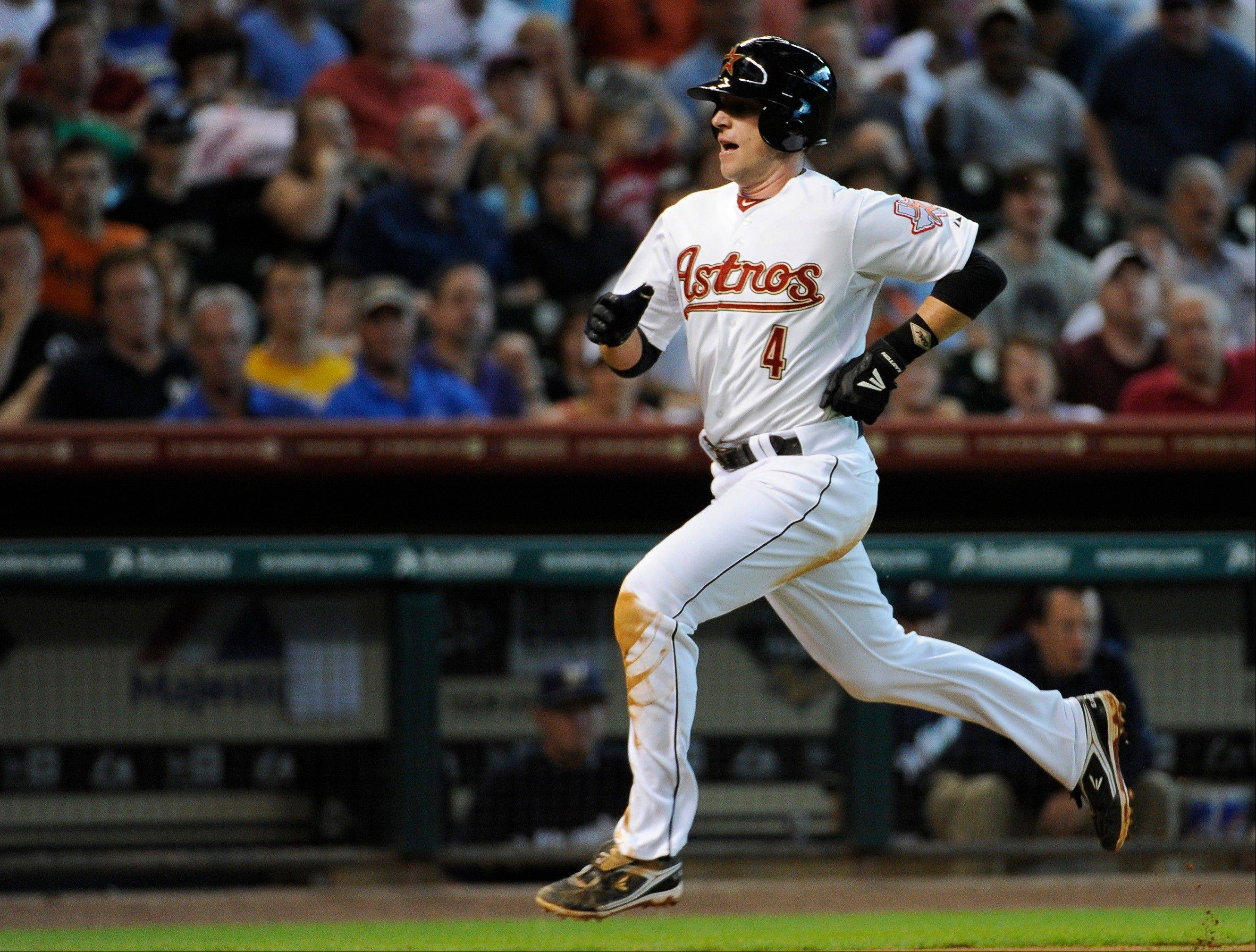 The Houston Astros' Jed Lowrie races home to score from third on a Jason Castro sacrifice fly against the Milwaukee Brewers Saturday during the fifth inning in Houston. The Astros won 6-3.