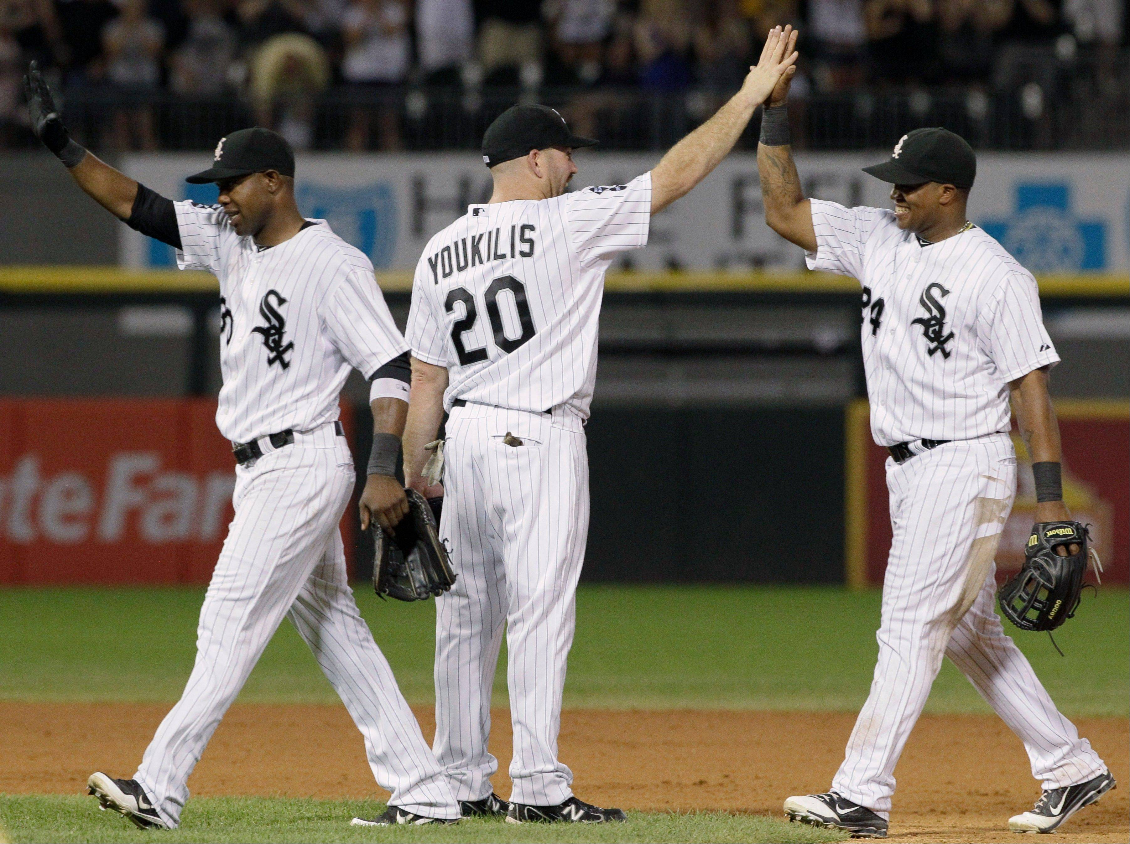 Alejandro De Aza, left, Kevin Youkilis and Dayan Viciedo celebrate the White Sox' victory over the Blue Jays on Friday night.