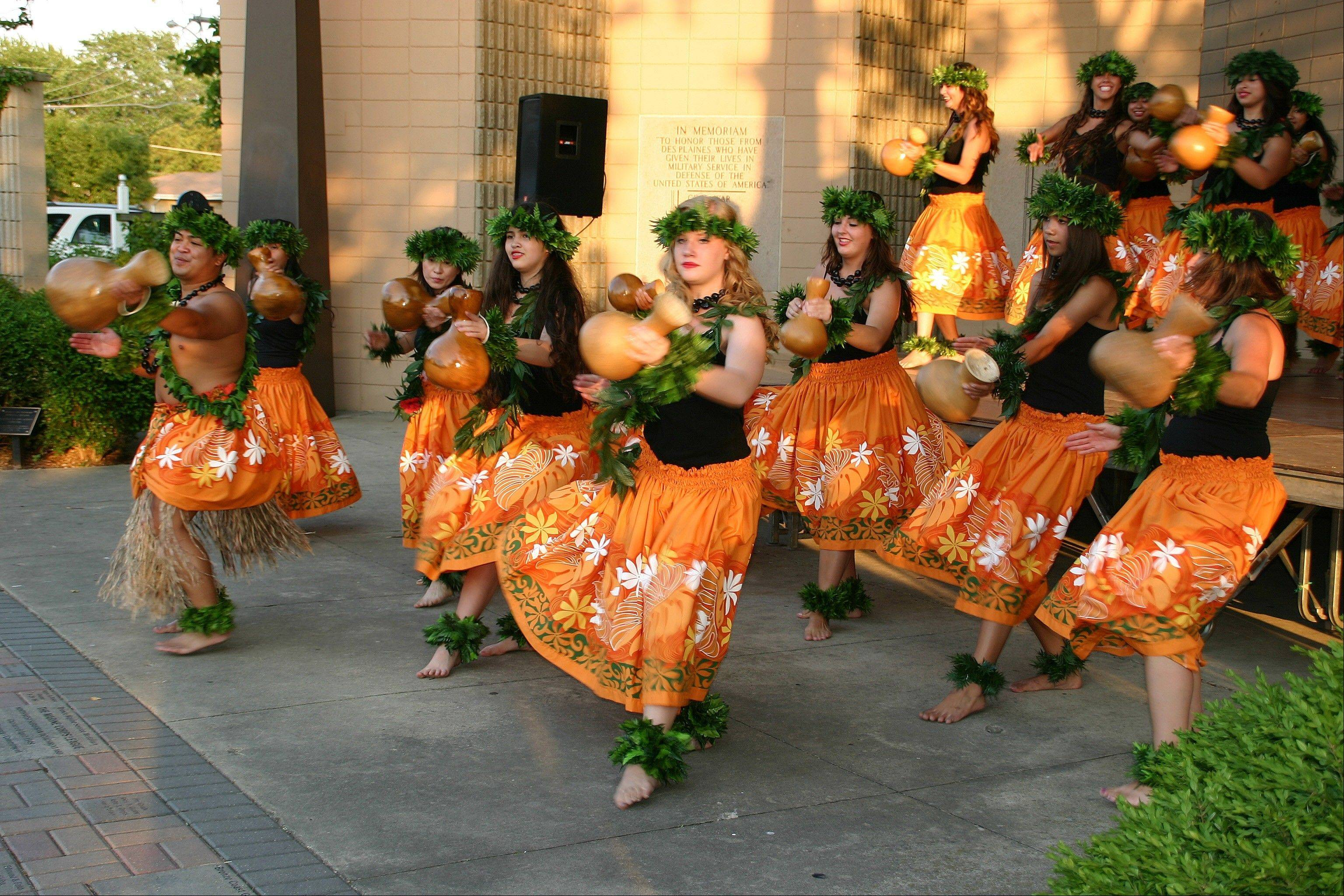 The professional dancers from The Barefoot Hawaiian beat the ipu, a traditional drum gourde, at the first of the Live at the Lake free summer concert programs at the Lake Park Memorial Pavilion. See the complete schedule at www.DPParks.org