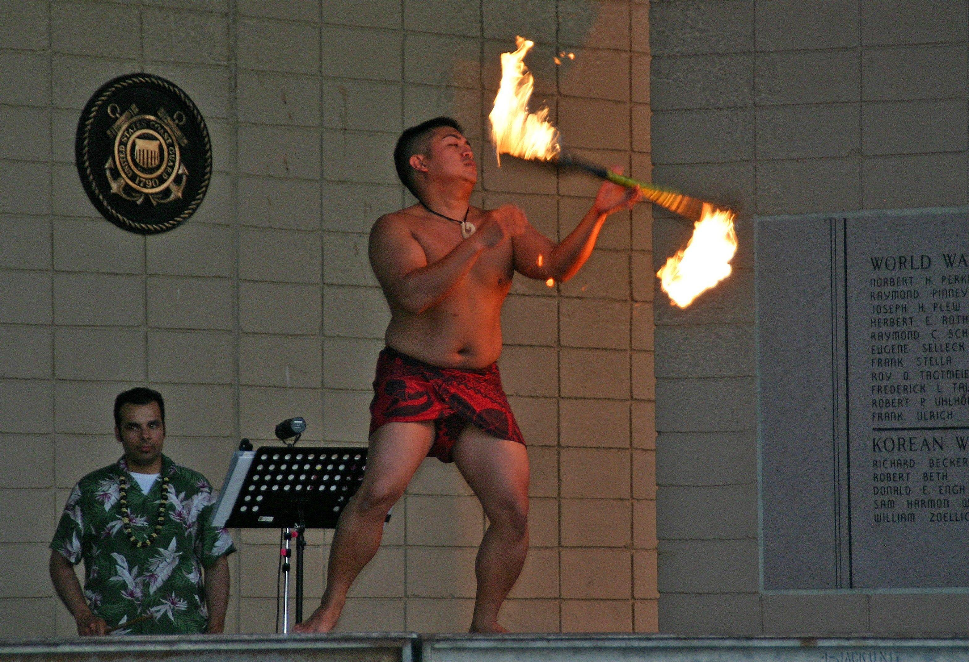 The Barefoot Hawaiian performs the traditional fire dance June 27, at the first Live at the Lake free performance.