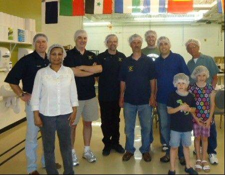 Helping the Feed My Starting Children Program are from left, back row, Knight Charlie Andrews, Knight Tom Varkados, Knight Bill Byrne, Knight Phil Riccio, Knight Brian Giangrego and John Wiszus; front row, Rosalind Andrews, Peter Chesek and Stephanie Chesek.