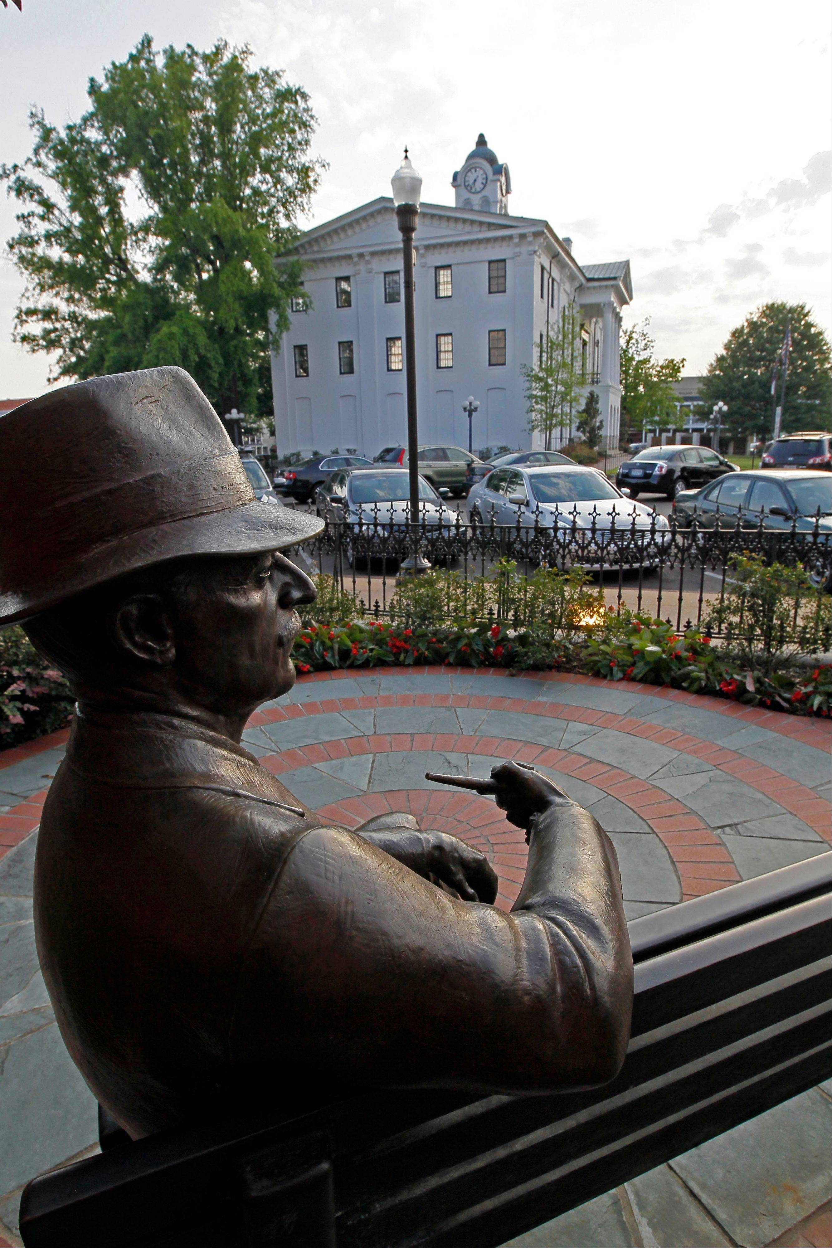 A life-size statue of the late Nobel Prize laureate William Faulkner sits in front of the Oxford, Miss., City Hall in the shadow of the county courthouse.