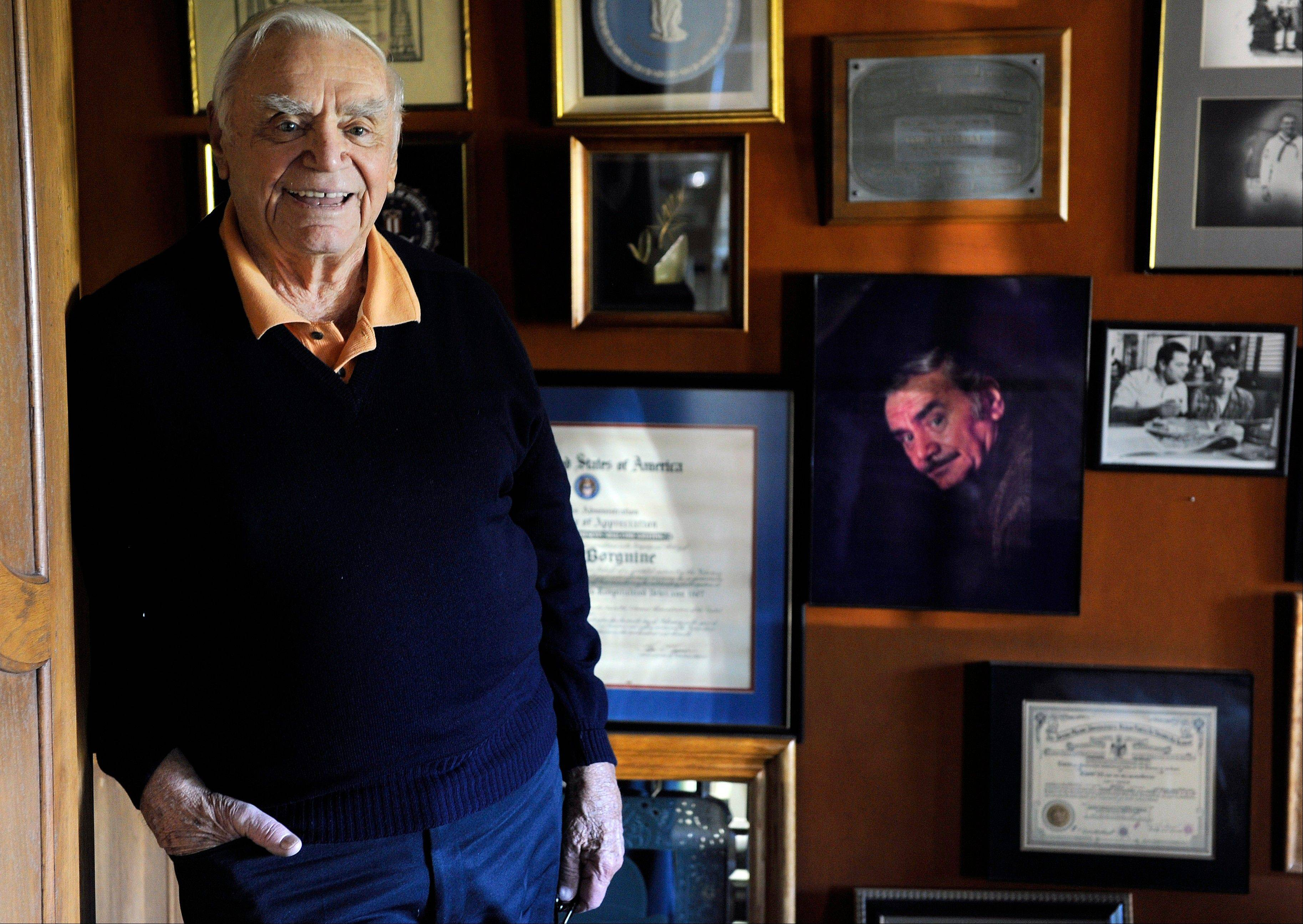 In this Oct. 26, 2010, file photo, actor Ernest Borgnine poses for a portrait at his home in Beverly Hills, Calif. A spokesman said Sunday that Borgnine has died at the age of 95.