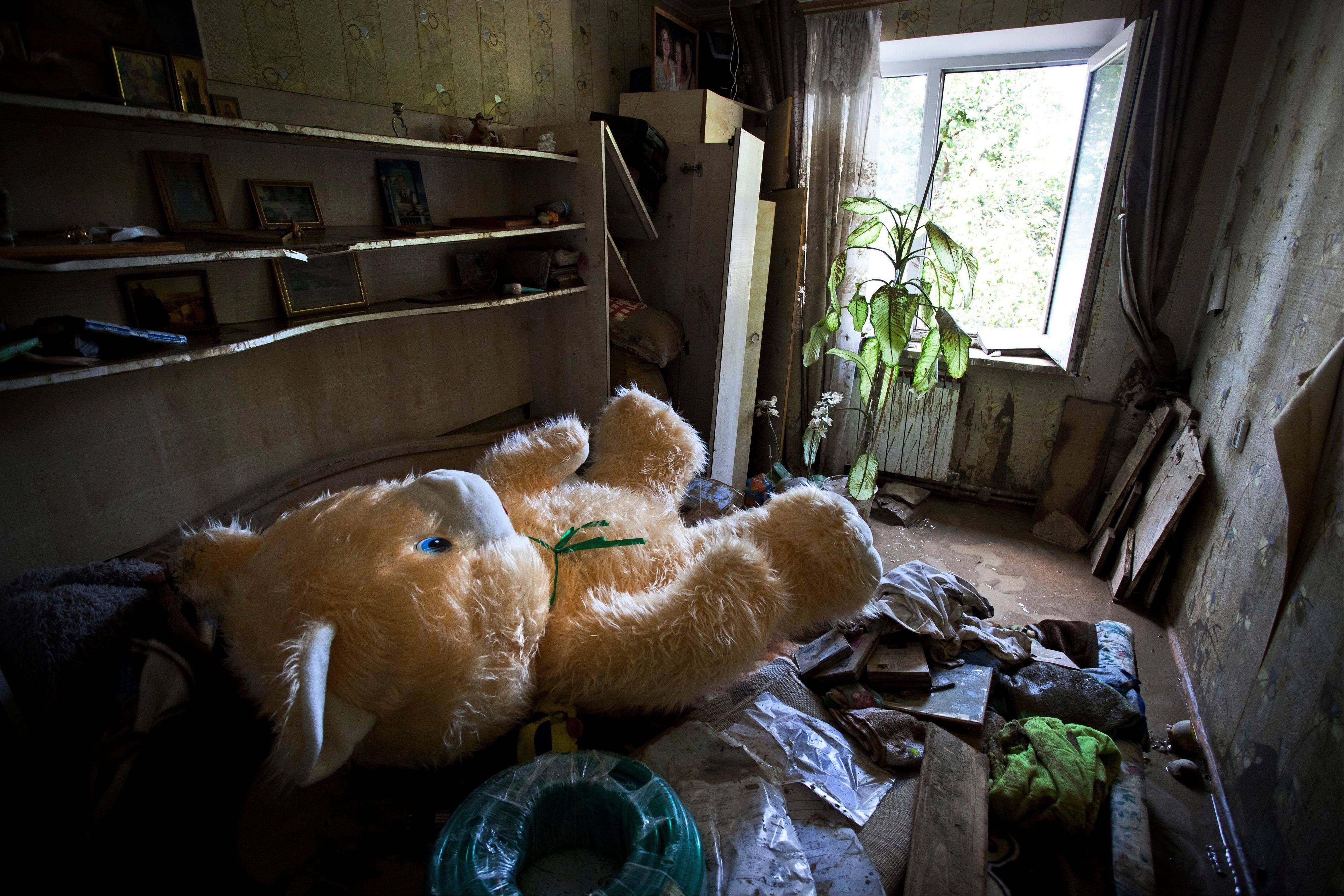 A teddy bear lying on a pile of garbage inside a flooded house Sunday in Krimsk, about 750 miles south of Moscow, Russia. The death toll from severe flooding in the Black Sea region of southern Russia has risen to at least 150.