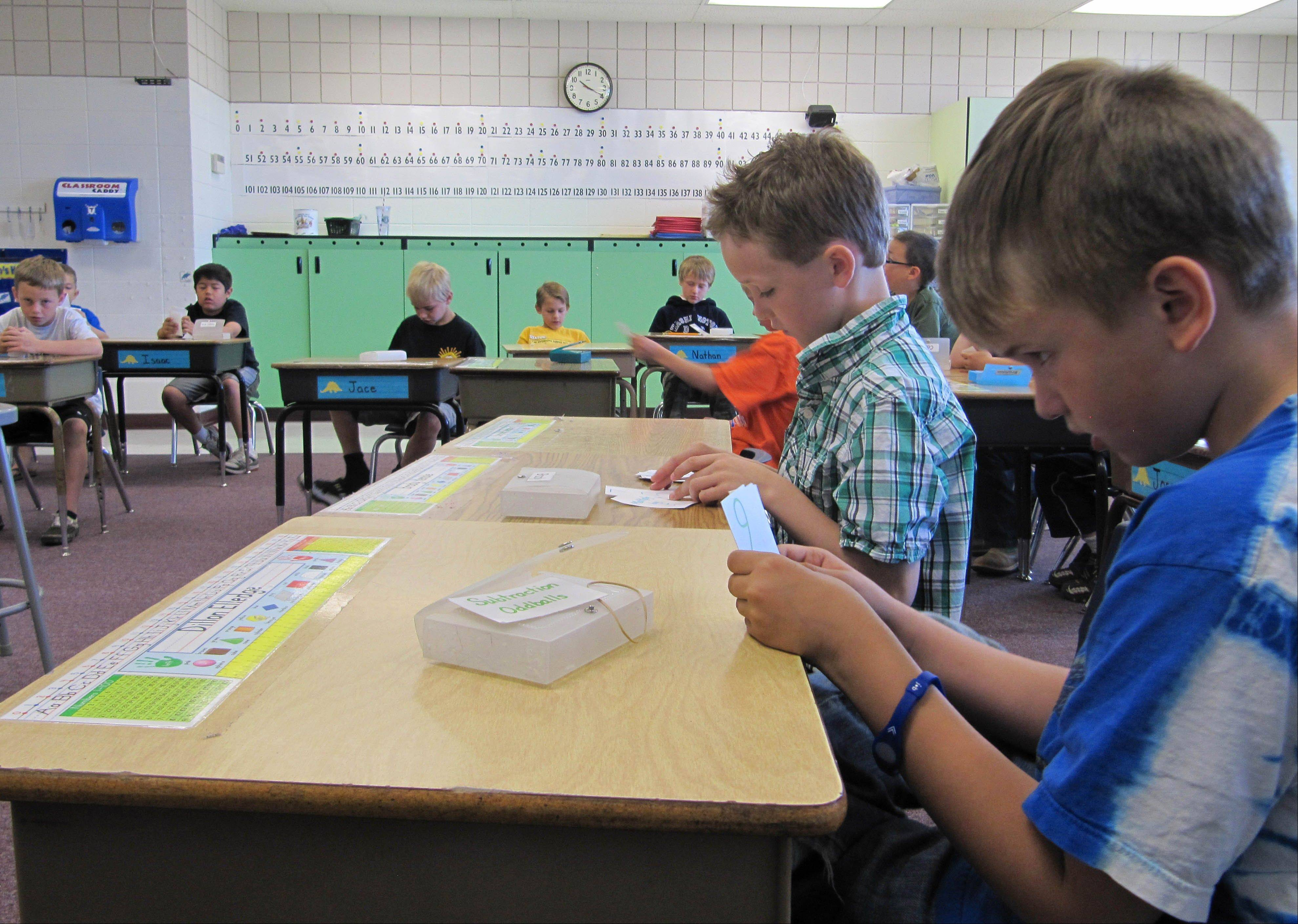 Dillon Elledge, 8, right, and Brody Kemble, 7, work with flash cards in May in their all-boys classroom at Middleton Heights Elementary in Middleton, Idaho. Middleton is believed to be the only public school in Idaho offering all-boy and all-girl classrooms.