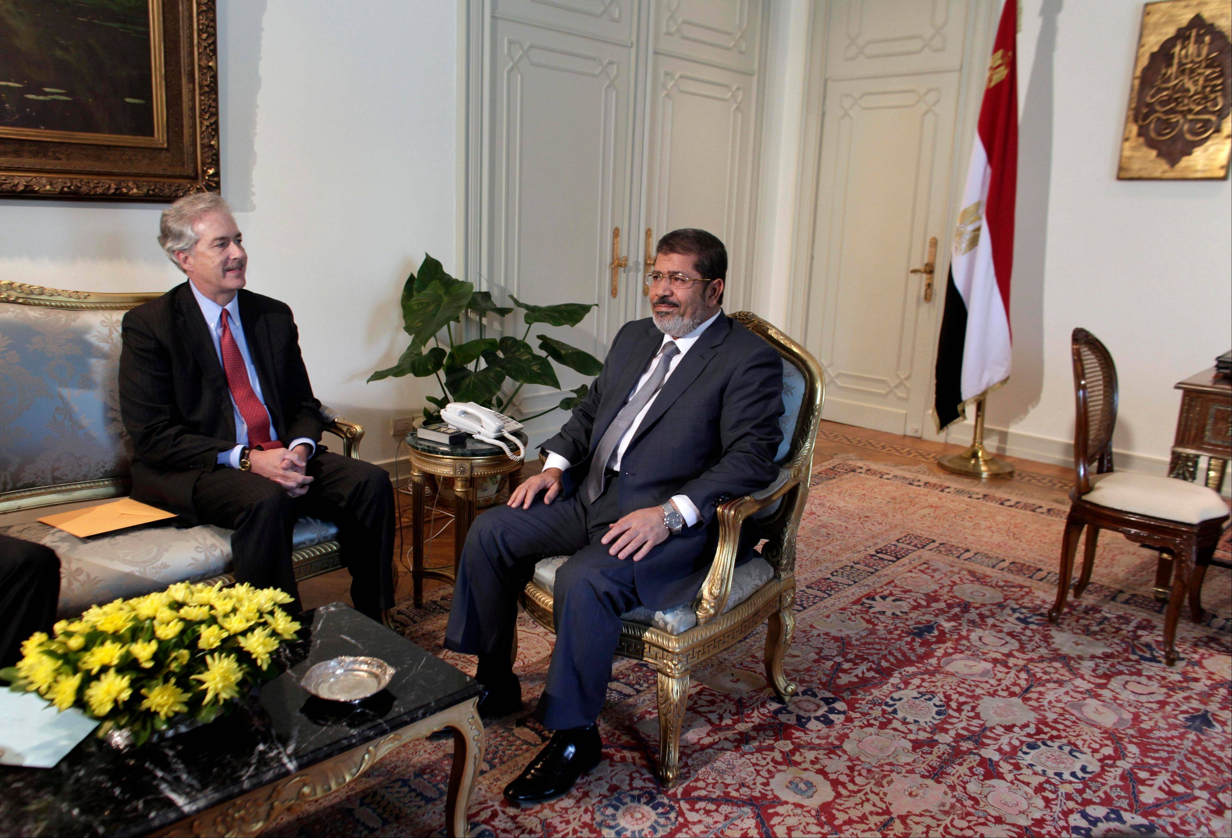 U.S. Undersecretary of State William Burns, left, meets with Egyptian President Mohammed Morsi at the presidential palace in Cairo, Egypt, on Sunday. Egypt's official news agency says Morsi has ordered the return of the country's Islamist-dominated parliament that was dissolved by the powerful military.