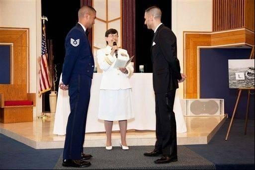 Navy Chaplain Kay Reeb of the Evangelical Lutheran Church of America officiates the civil union ceremony of Air Force Tech. Sgt. Erwynn Umali, right, and his partner, Will Behrens, last month at Joint Base McGuire-Dix-Lakehurst, the military base in Wrightstown, N.J., where Umali is stationed.