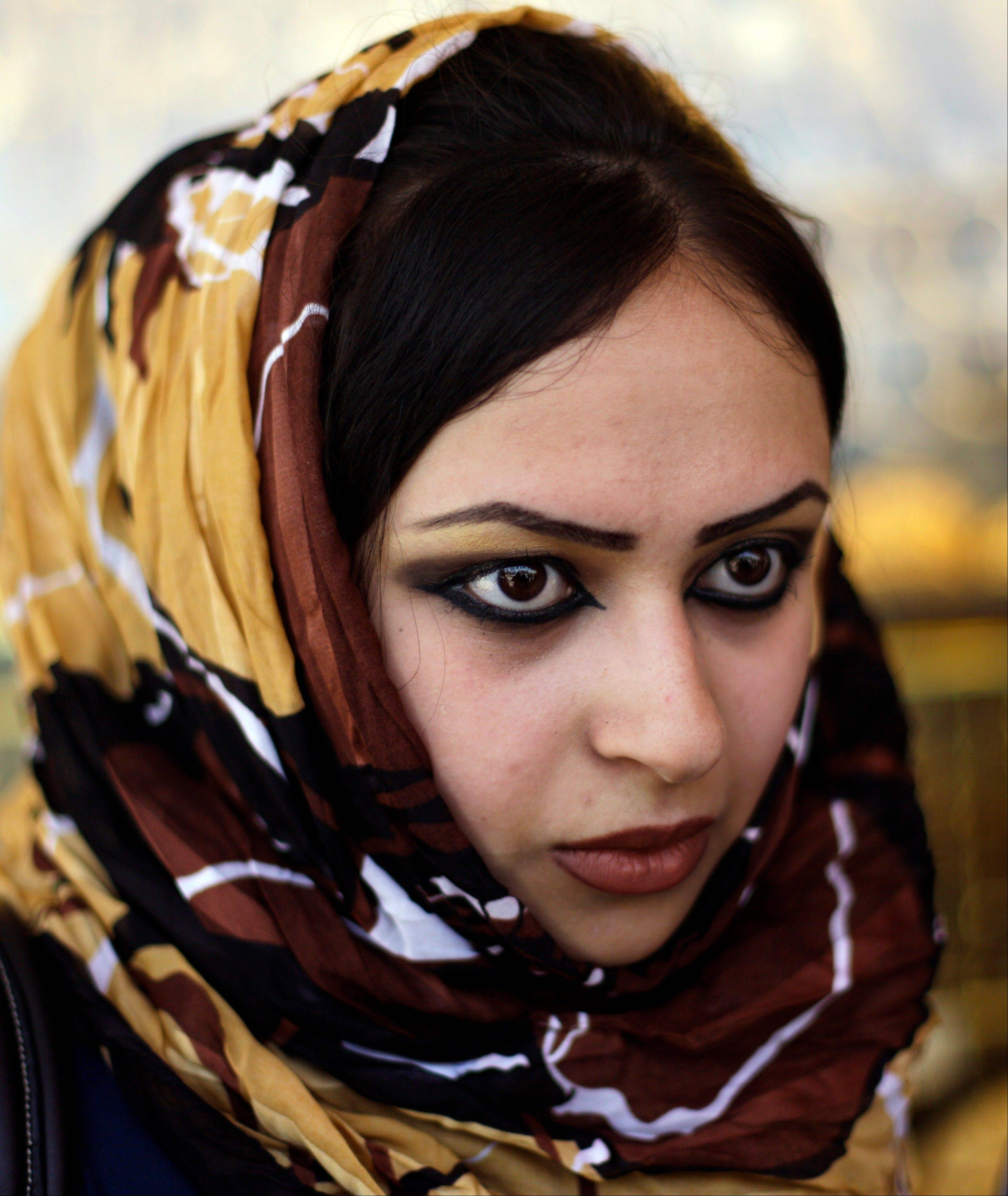 "Aya Salah, 21, a Sunni Muslim, speaks to the Associated Press in the Mansour neighborhood of Baghdad, Iraq, Wednesday, July 4, 2012. ""There is a lot of fear, and it keeps me from going out. My parents won't allow me to go out alone,"" she says."