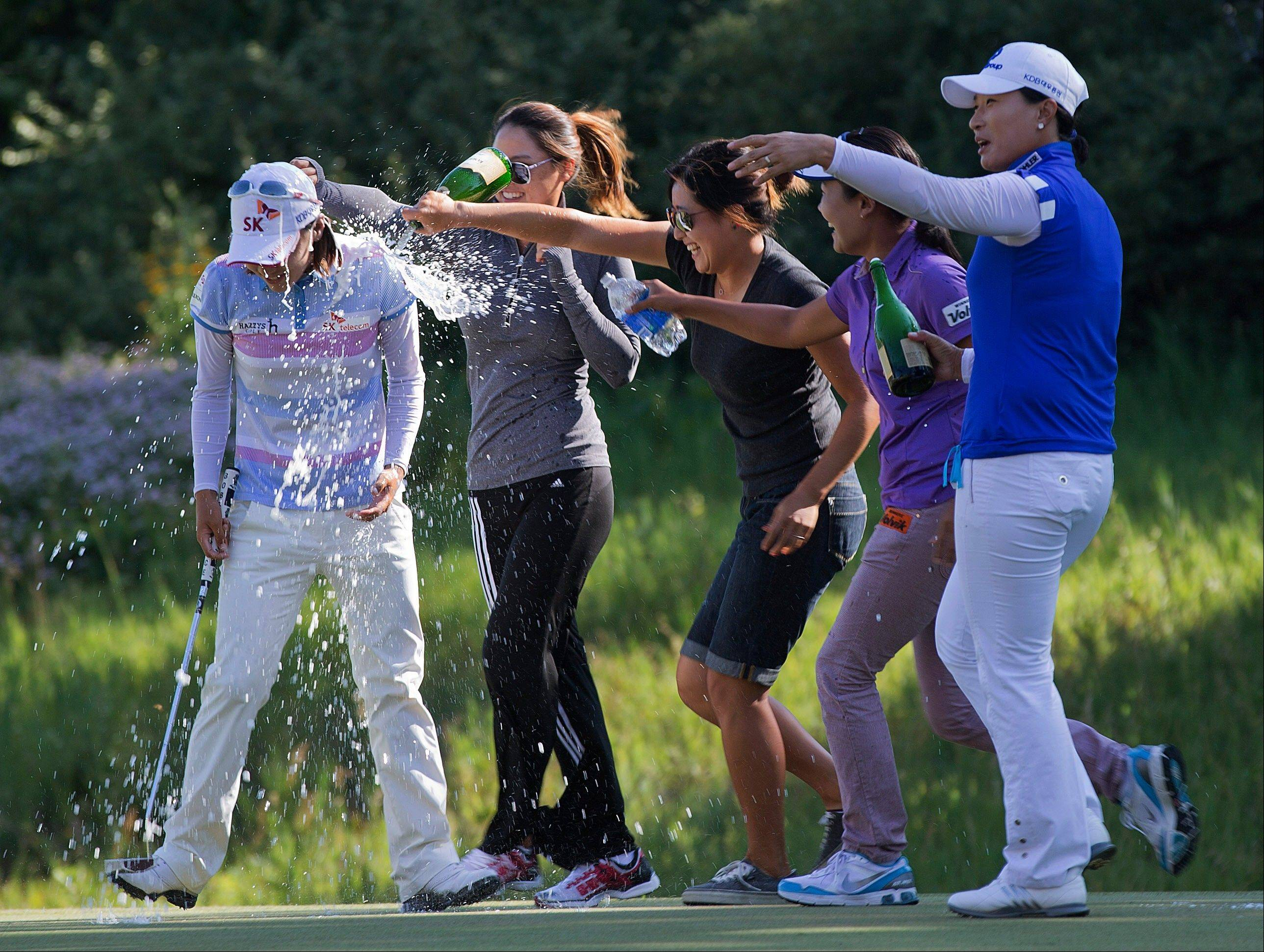South Korea's Na Yeon Choi, far left, is doused by Se Ri Pak, far right, and others after winning the U.S. Women's Open on Sunday in Kohler, Wis.