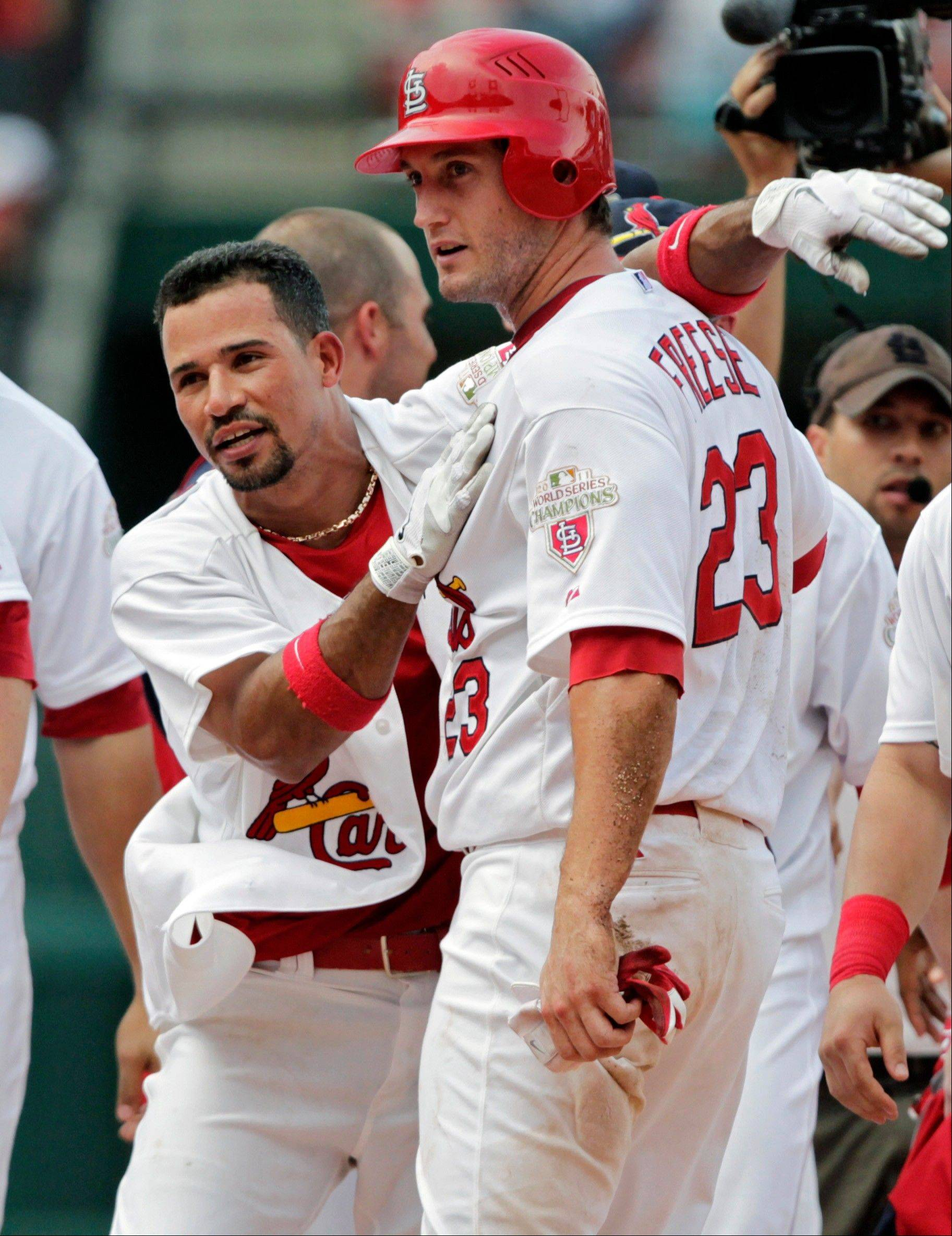The Cardinals' Rafael Furcal celebrates with David Freese after their 5-4 win over the Miami Marlins on Sunday in St. Louis. Freese scored the winning run on a single hit by Furcal.