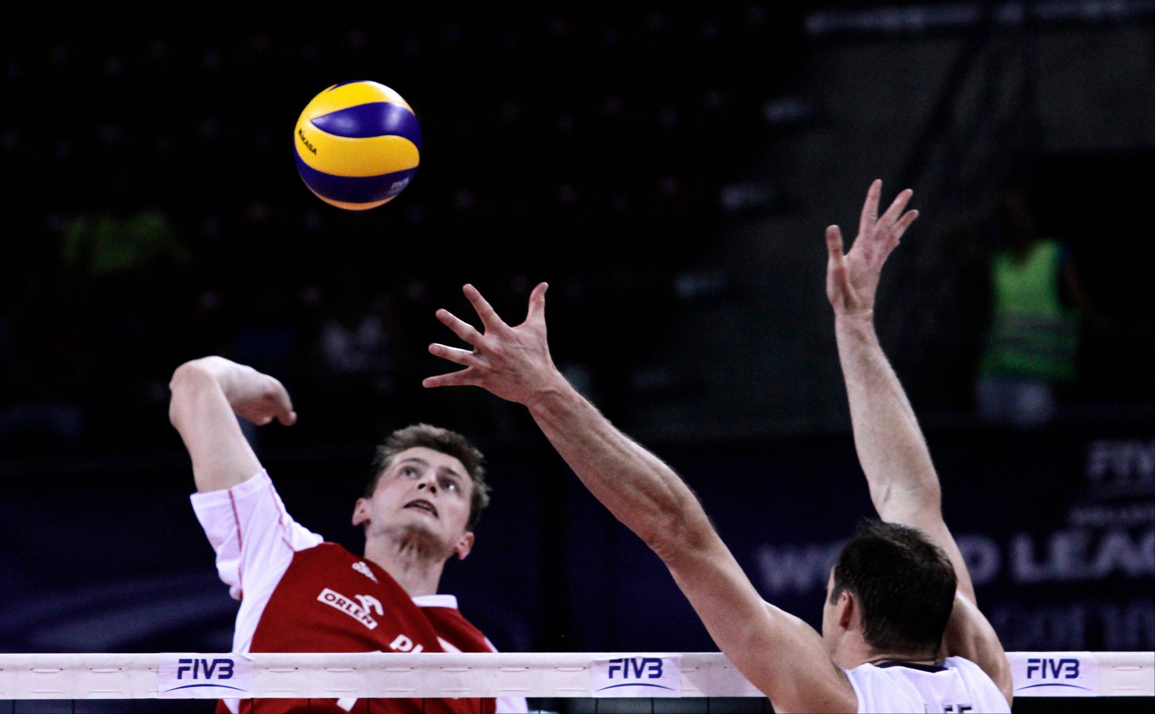 Poland's Piotr Nowakowski spikes the ball against David Lee of the U.S. during the 2012 FIVB World League Volleyball final match Sunday in Sofia, Bulgaria.