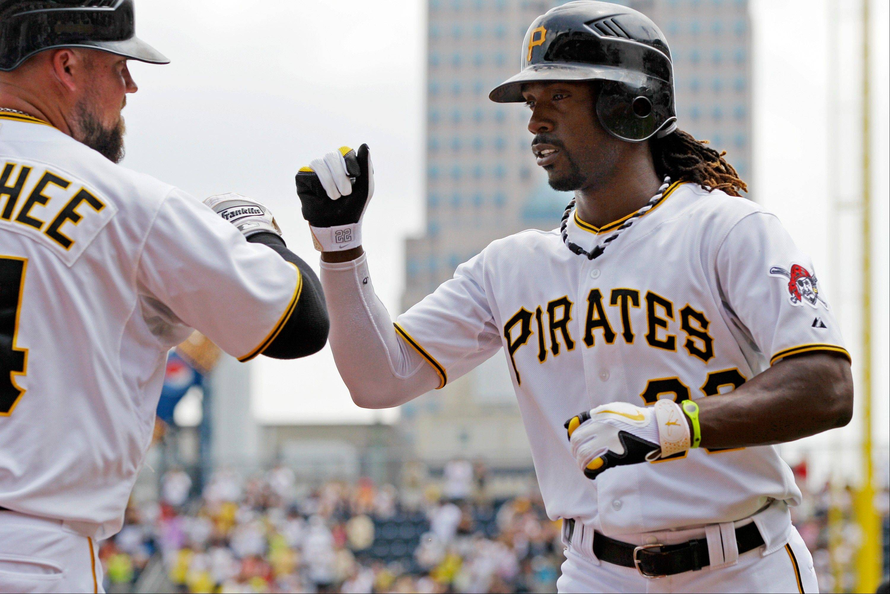 The Pirates' Andrew McCutchen, right, celebrates with teammate Casey McGhee after hitting a two-run home run off San Francisco pitcher Tim Lincecum during the first inning Sunday in Pittsburgh.
