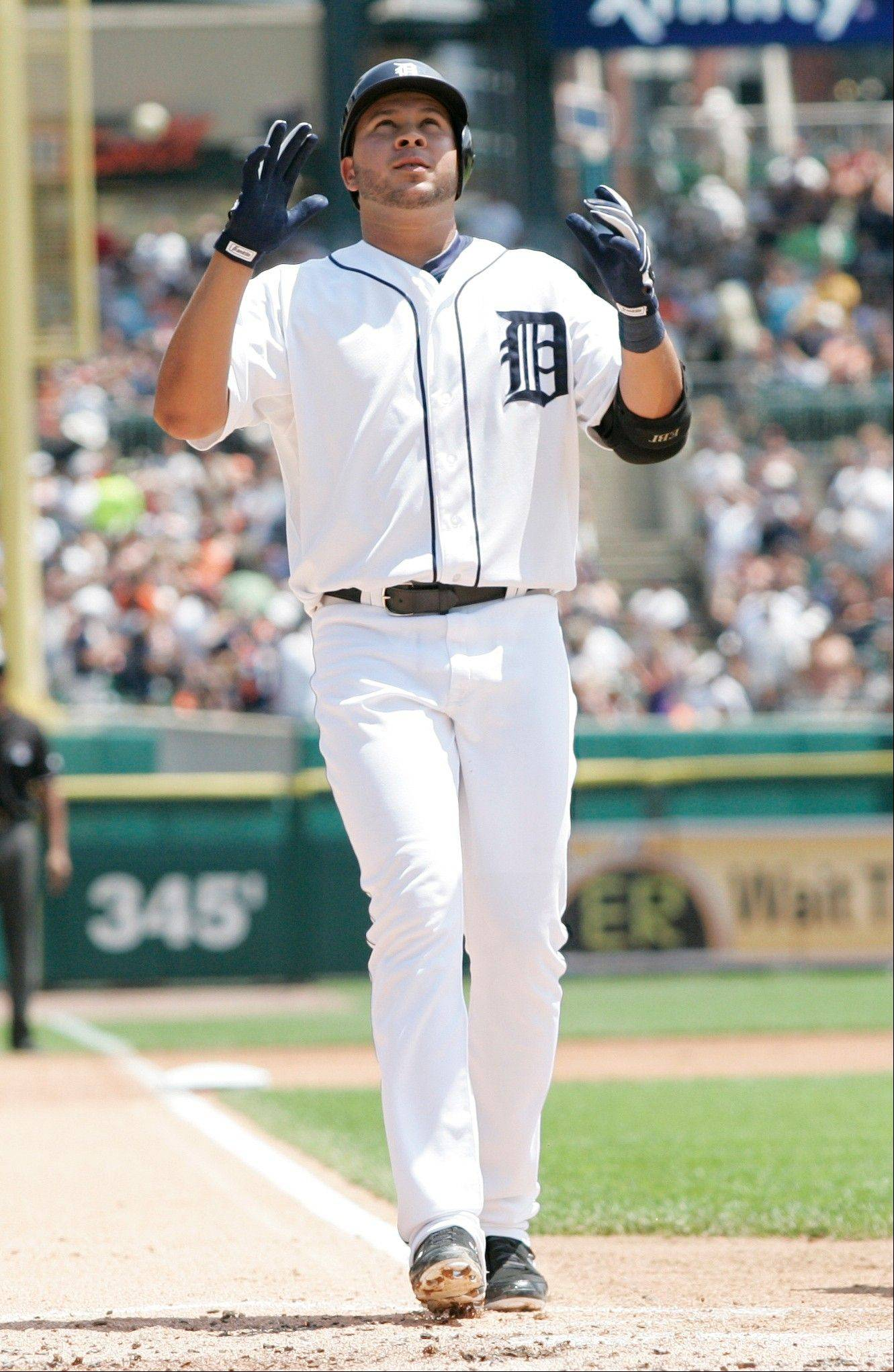 The Tigers' Jhonny Peralta crosses home plate after hitting a two-run home run against the Kansas City in the second inning Sunday in Detroit.