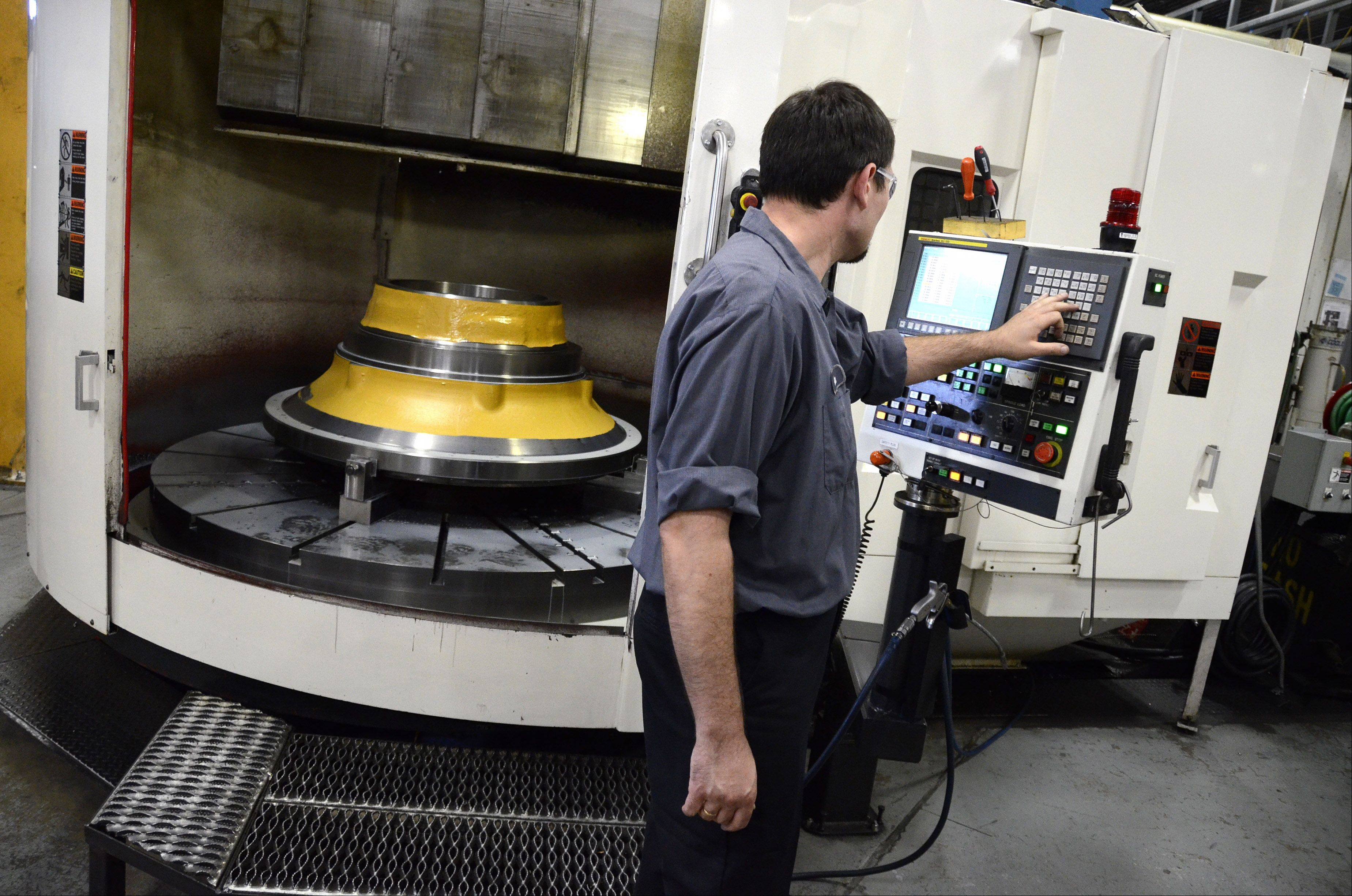 An Acme Industries employee works at the company's Elk Grove Village manufacturing plant.