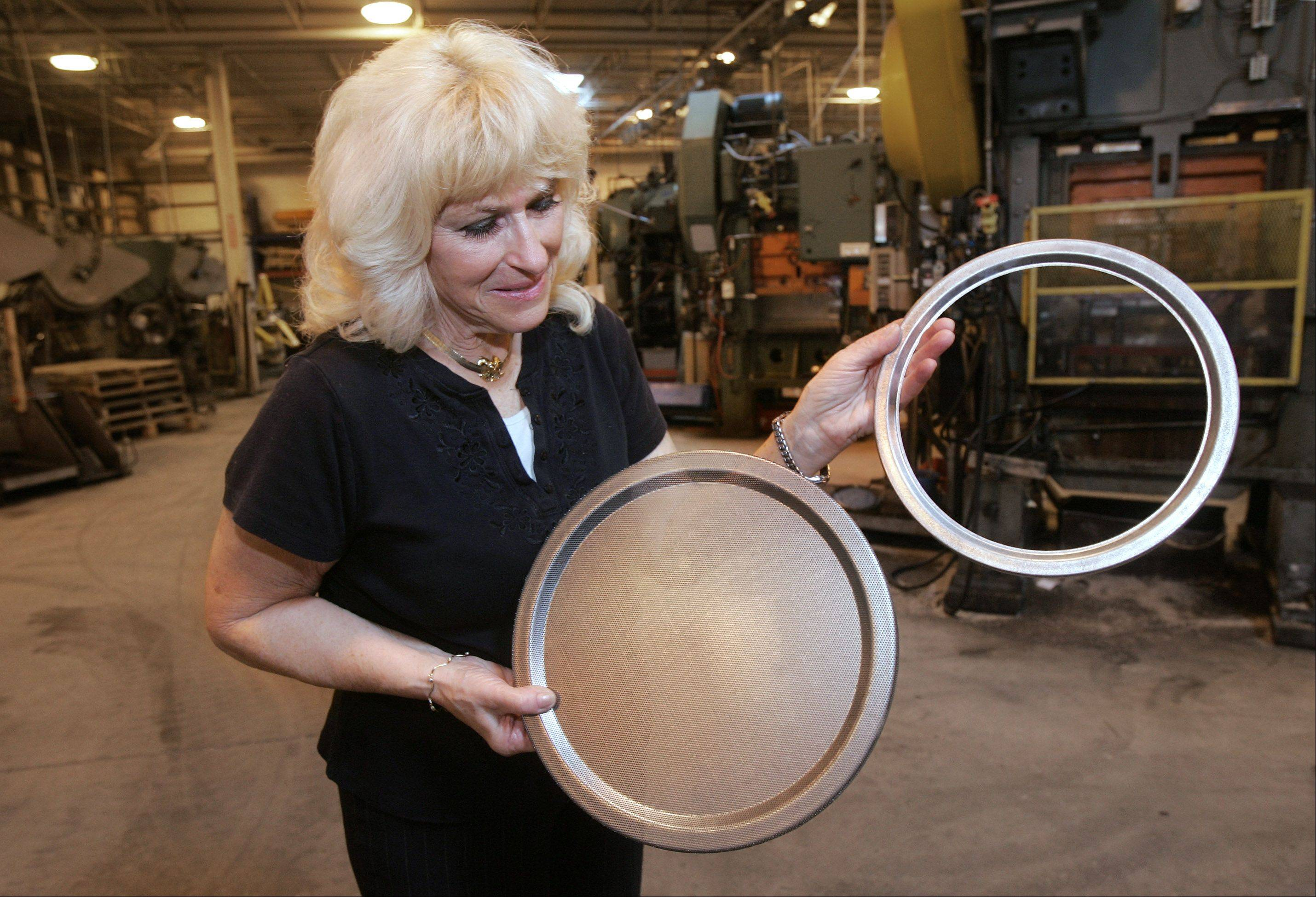 Domeny Tool and Stamping President Marge Domeny discusses products the Wauconda company manufactures. Hers is one of more than 50 area manufacturers to team with Harper College in Palatine for a new advanced manufacturing program.