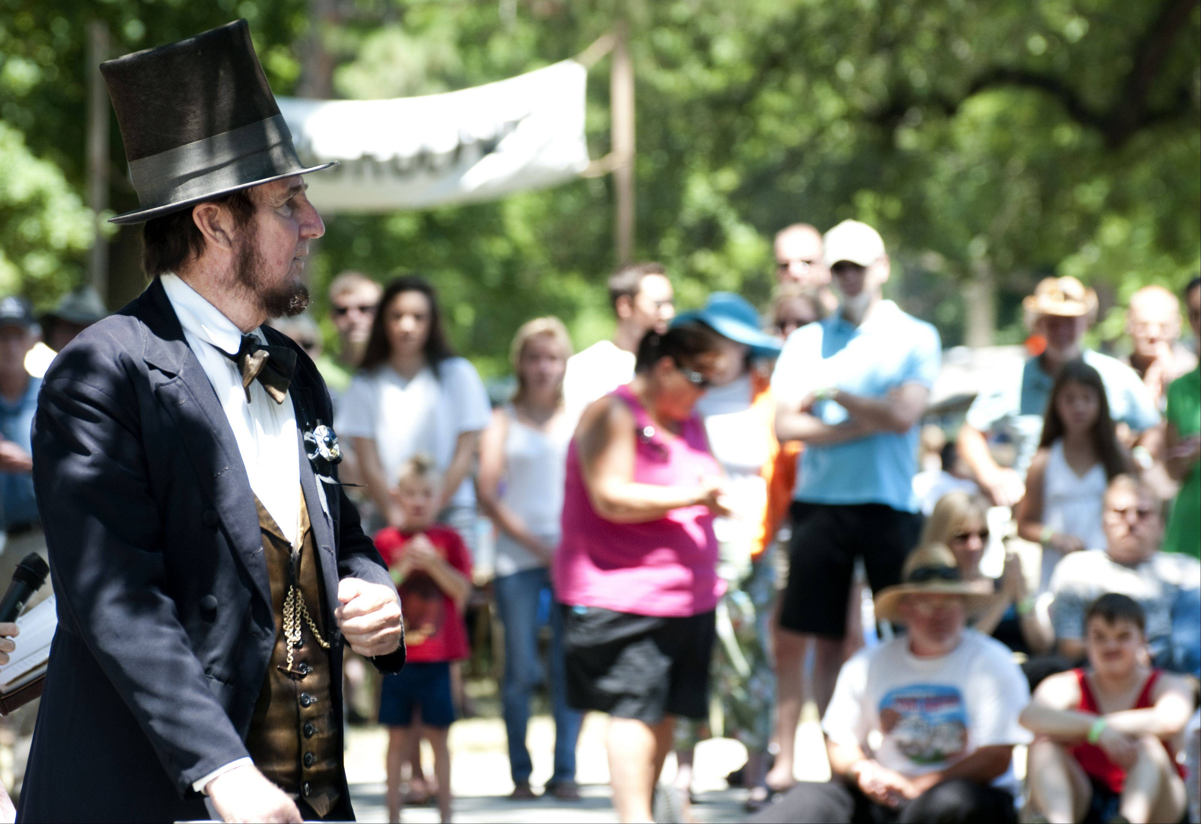 An Abraham Lincoln impersonator delivers a speech to the crowd during Civil War Days Sunday in the Lakewood Forest Preserve near Wauconda. Lincoln, as well Harriet Tubman, Sojourner Truth, Ulysses S. Grant and Robert E. Lee made appearances and interacted with crowd members.