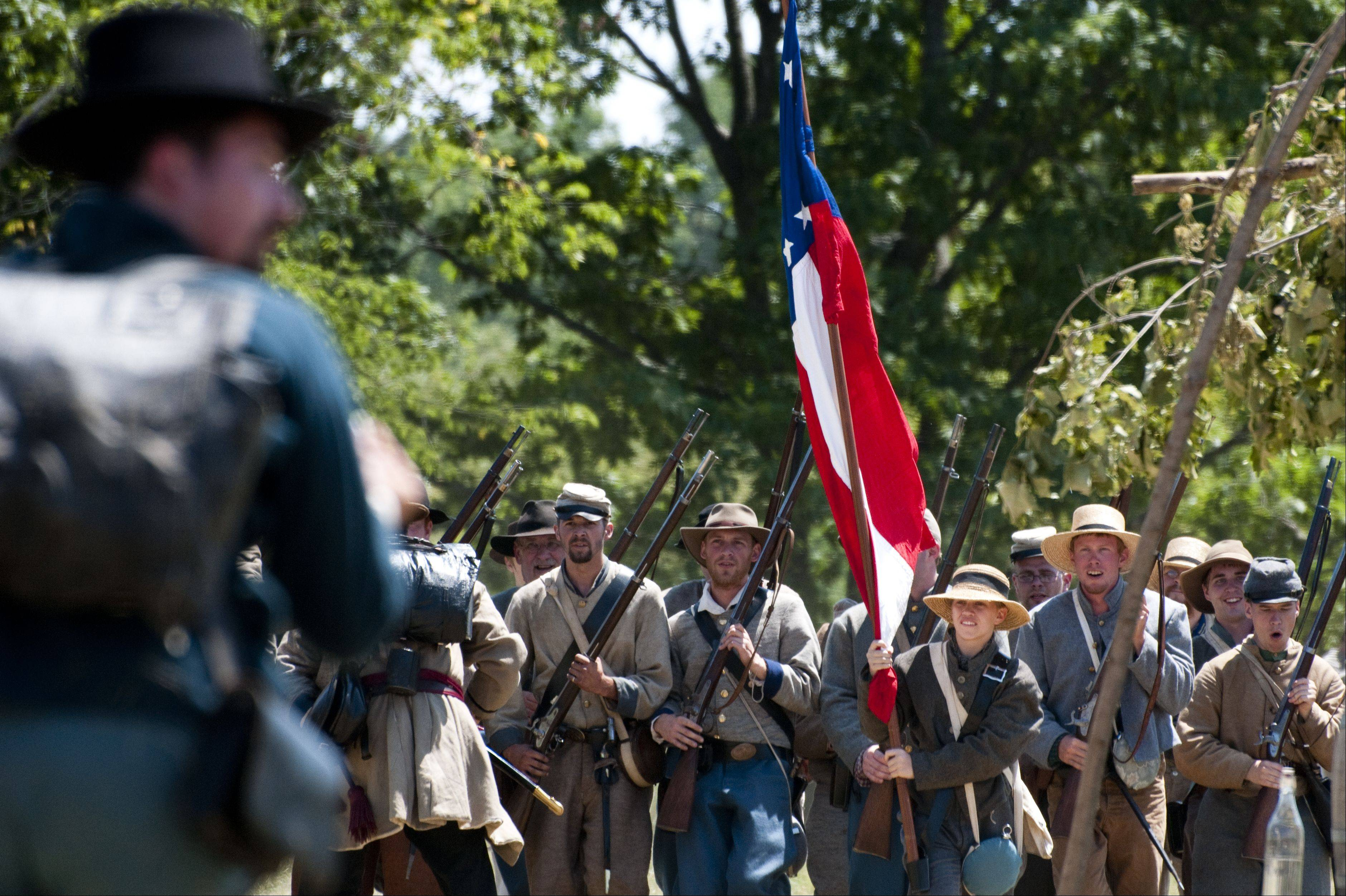 Disbanded Confederate soldiers stage a final rally against a Union flanking maneuver during Civil War Days Sunday in the Lakewood Forest Preserve near Wauconda.