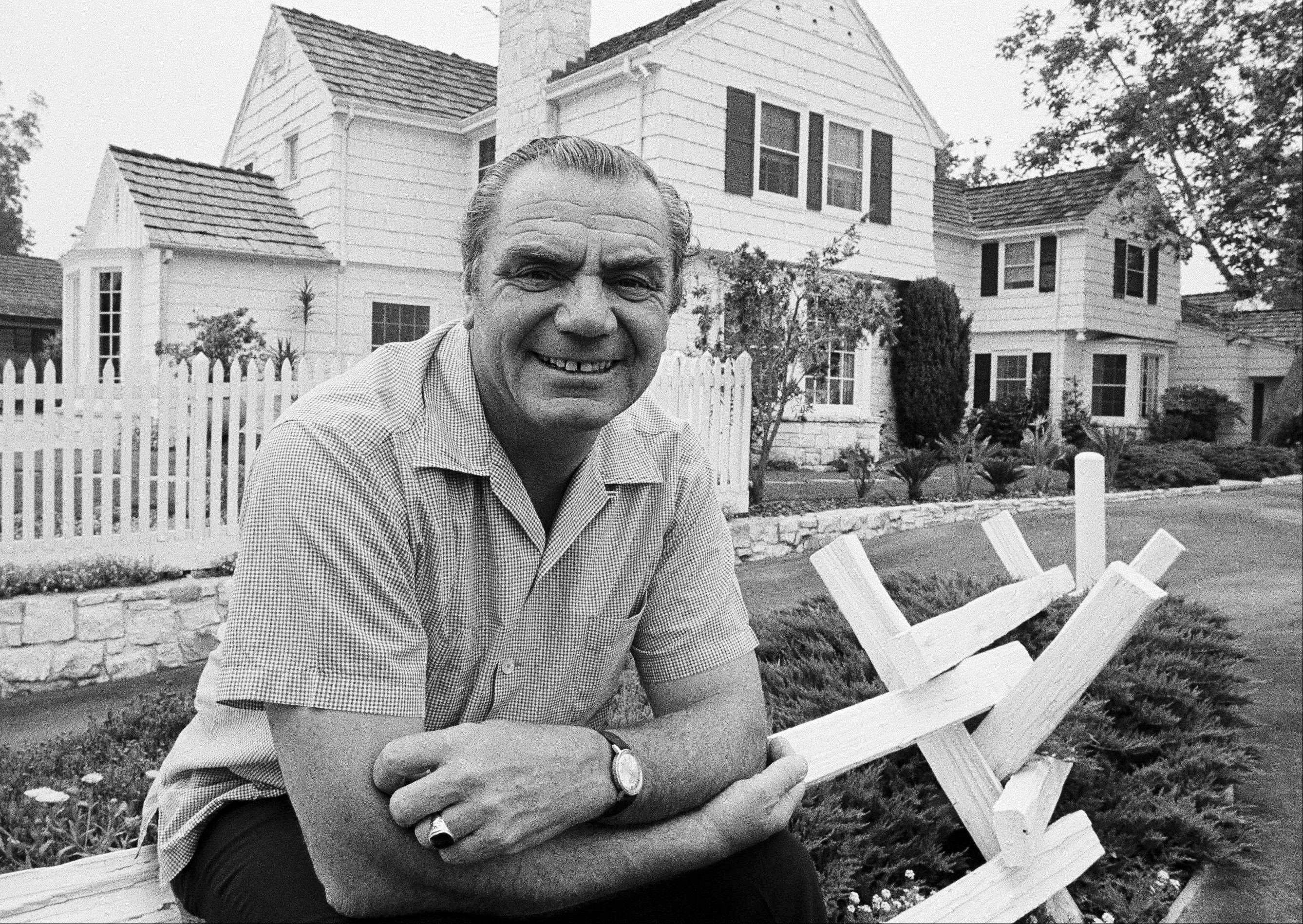 FILE - In this July 1, 1969, file photo, actor Ernest Borgnine poses in front of his home in the mountains above Hollywood, Calif. A spokesman said Sunday, July 8, 2012, that Borgnine has died at the age of 95.