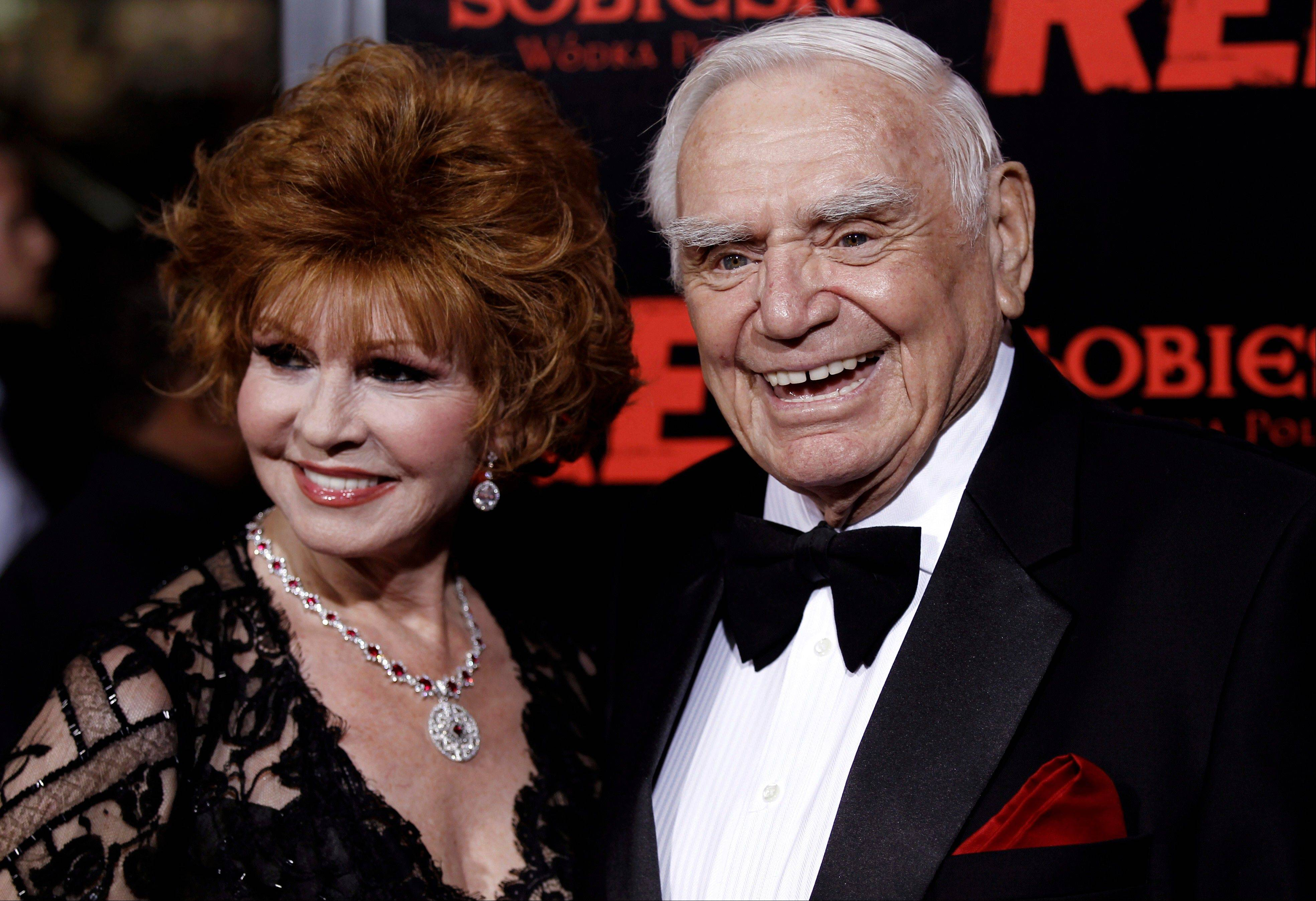 "FILE - In this Oct. 11, 2010, file photo, cast member Ernest Borgnine, right, and his wife, Tova, arrive at a special screening of the film ""Red"" in Los Angeles. A spokesman said Sunday, July 8, 2012, that Borgnine has died at the age of 95."