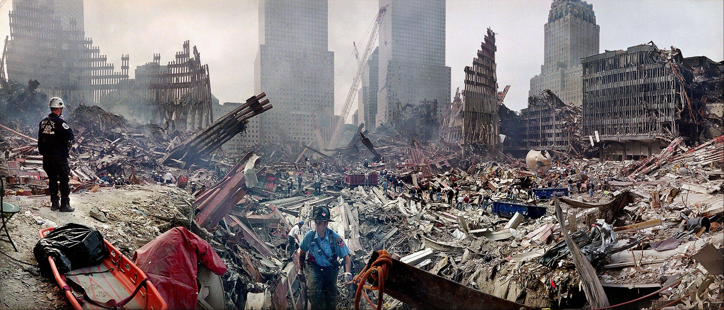 Rescue workers examine the site of the Sept. 11, 2001 World Trade Center terrorist attacks in New York. Several experts say there's no hard evidence to support the federal government's declaration that 50 kinds of cancer could be caused by exposure to World Trade Center dust.