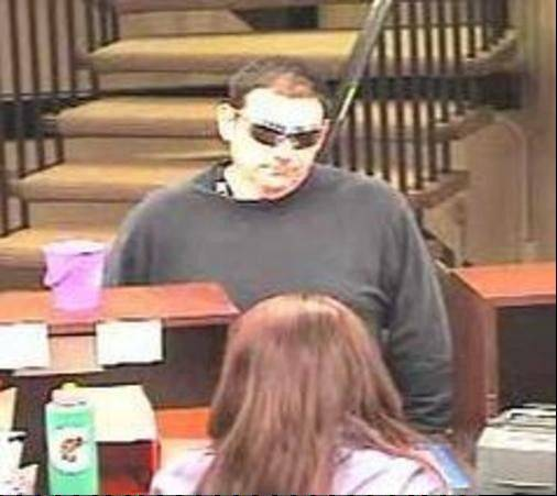 Police released this surveillance photo of a man who robbed the Chase Bank. 123 W. Main Street, in Bensenville on April 2. The same man is suspected of robbing the Elmhurst Inland Bank and Trust at 539 S. Spring Road Monday morning for the second time in two months.