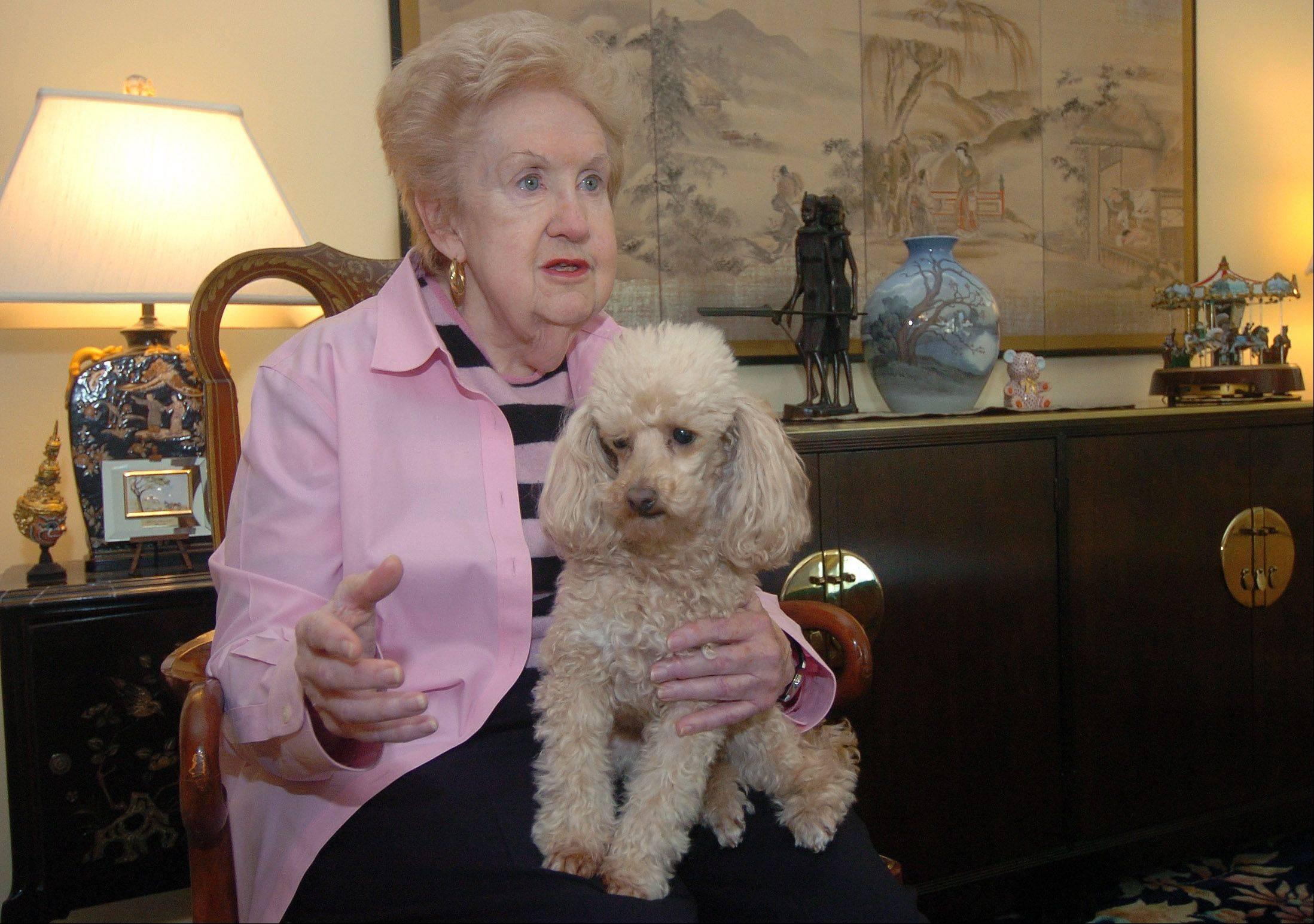 Carole Nolan, with her dog, Millie, inside her condo at the Moorings, a retirement community in Arlington Heights, shortly after she was inducted into the Illinois Seniors' Hall of Fame.