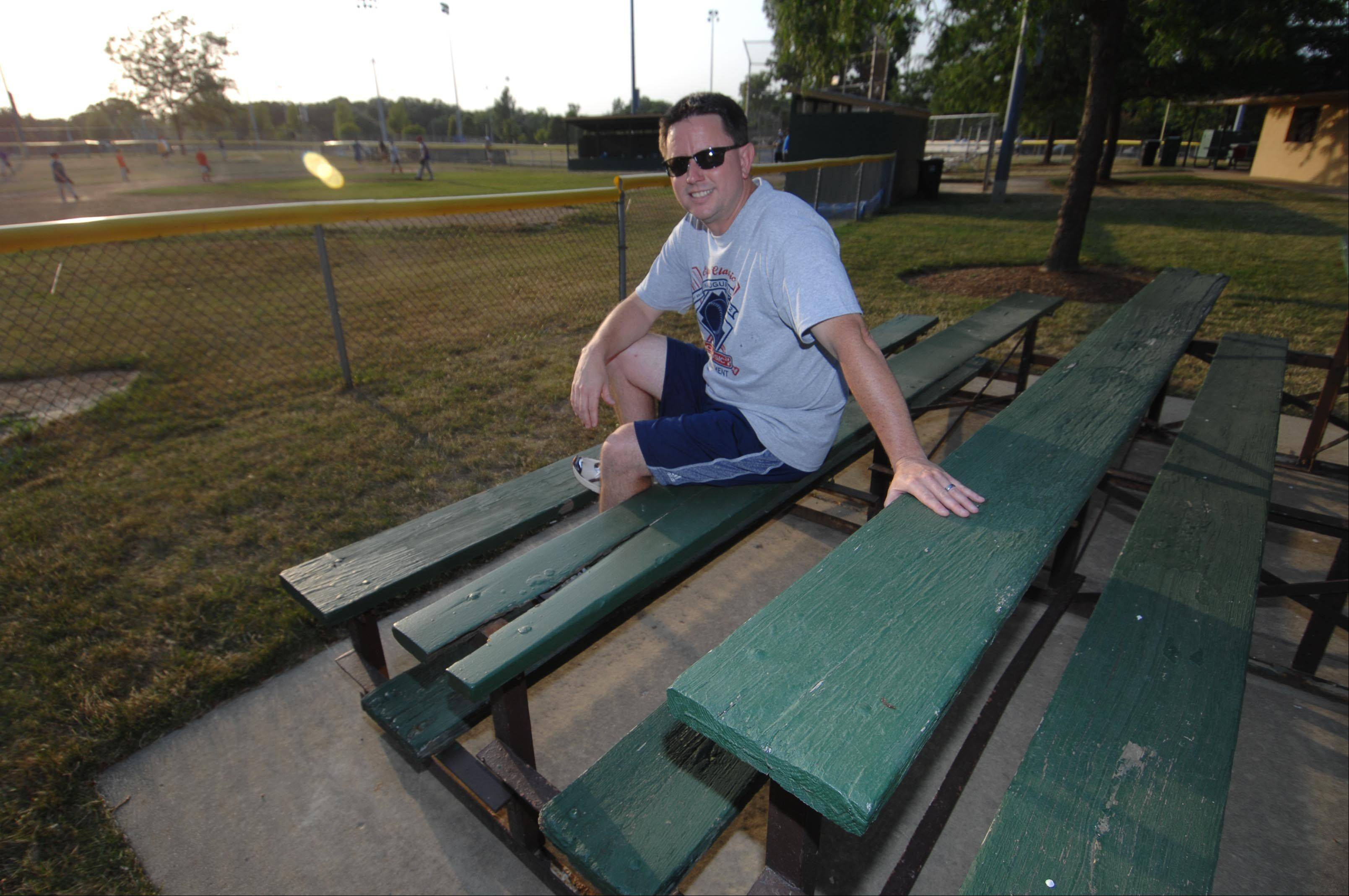 Brad Heath, president of the Elgin Classic Little League, plans to use a grant to replace old bleachers in Wing Park.